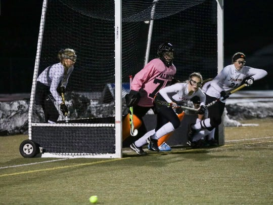 Palmyra defenders prepare to stop a Donegal corner play during Friday's state championship game.