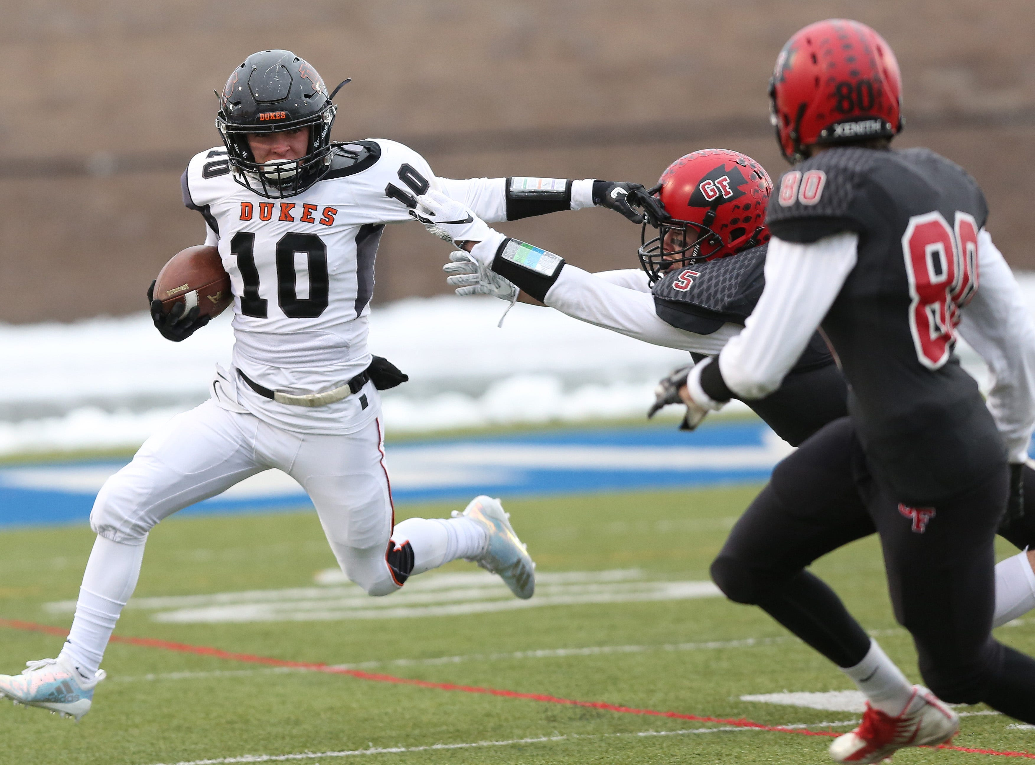 Marlboro's Eric Borchert (10) tries to find some running room in the Glens Falls defense during the state Class B semifinal game at Middletown High School Nov. 17, 2018.