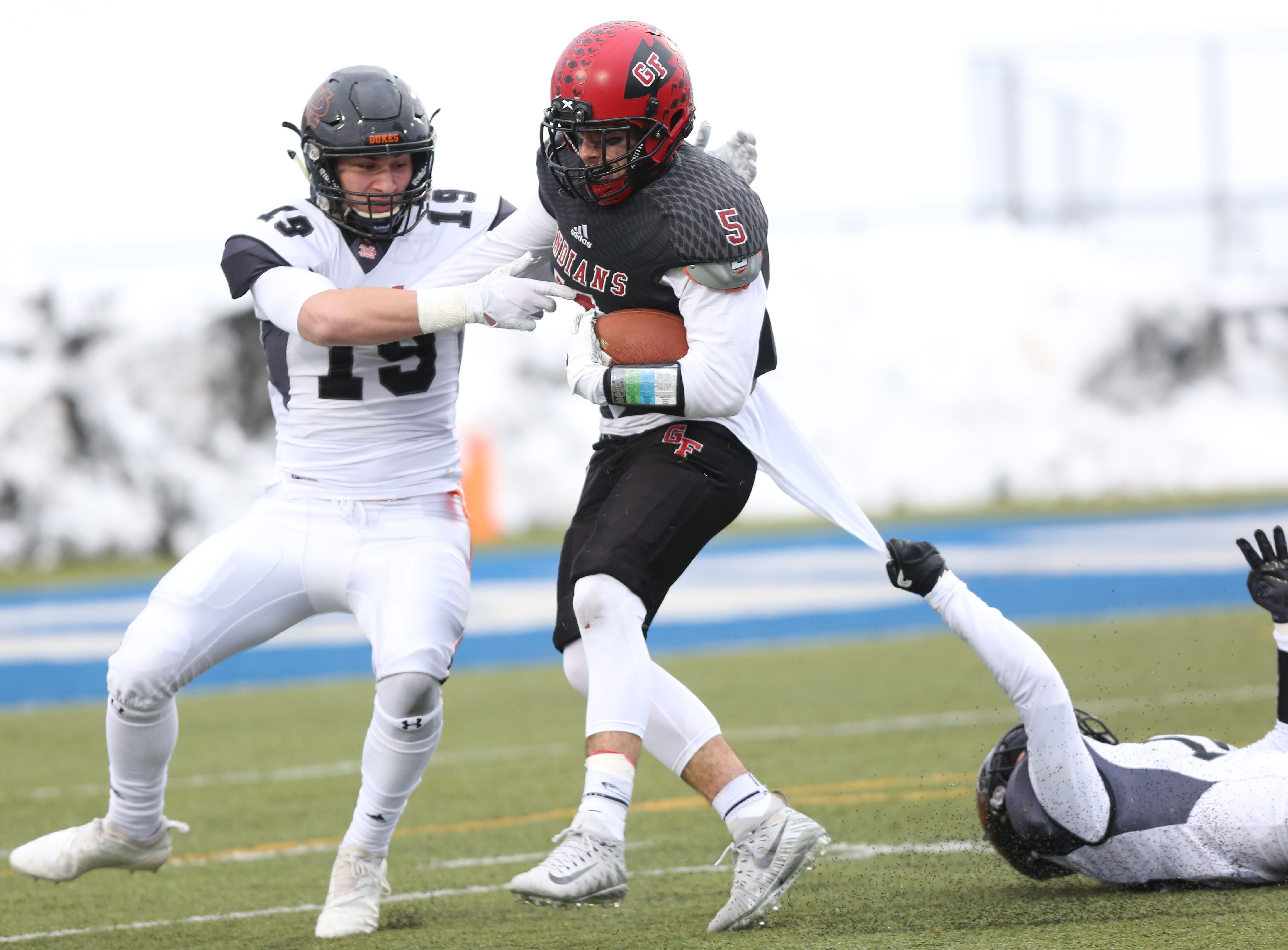 Glens Falls' David Barclay (5) tries to break away from Marlboro's Jack Young (19) and Eric Borchert (10)  during the state Class B semifinal game at Middletown High School Nov. 17, 2018.