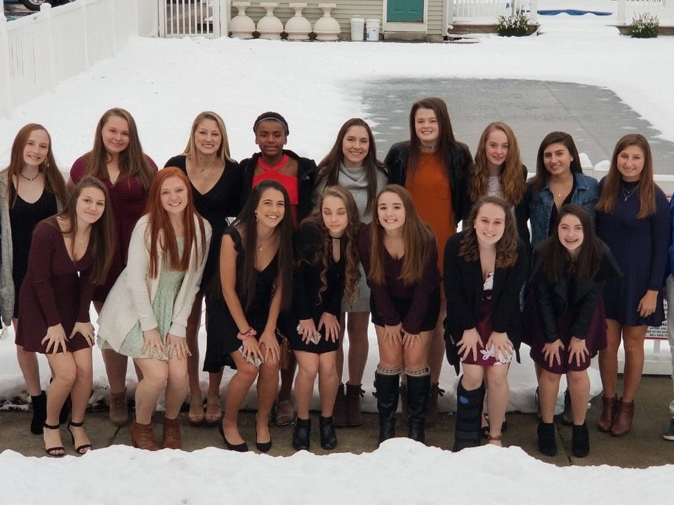 The Millbrook High School volleyball team poses before the state tournament banquet in Glens Falls on Friday.