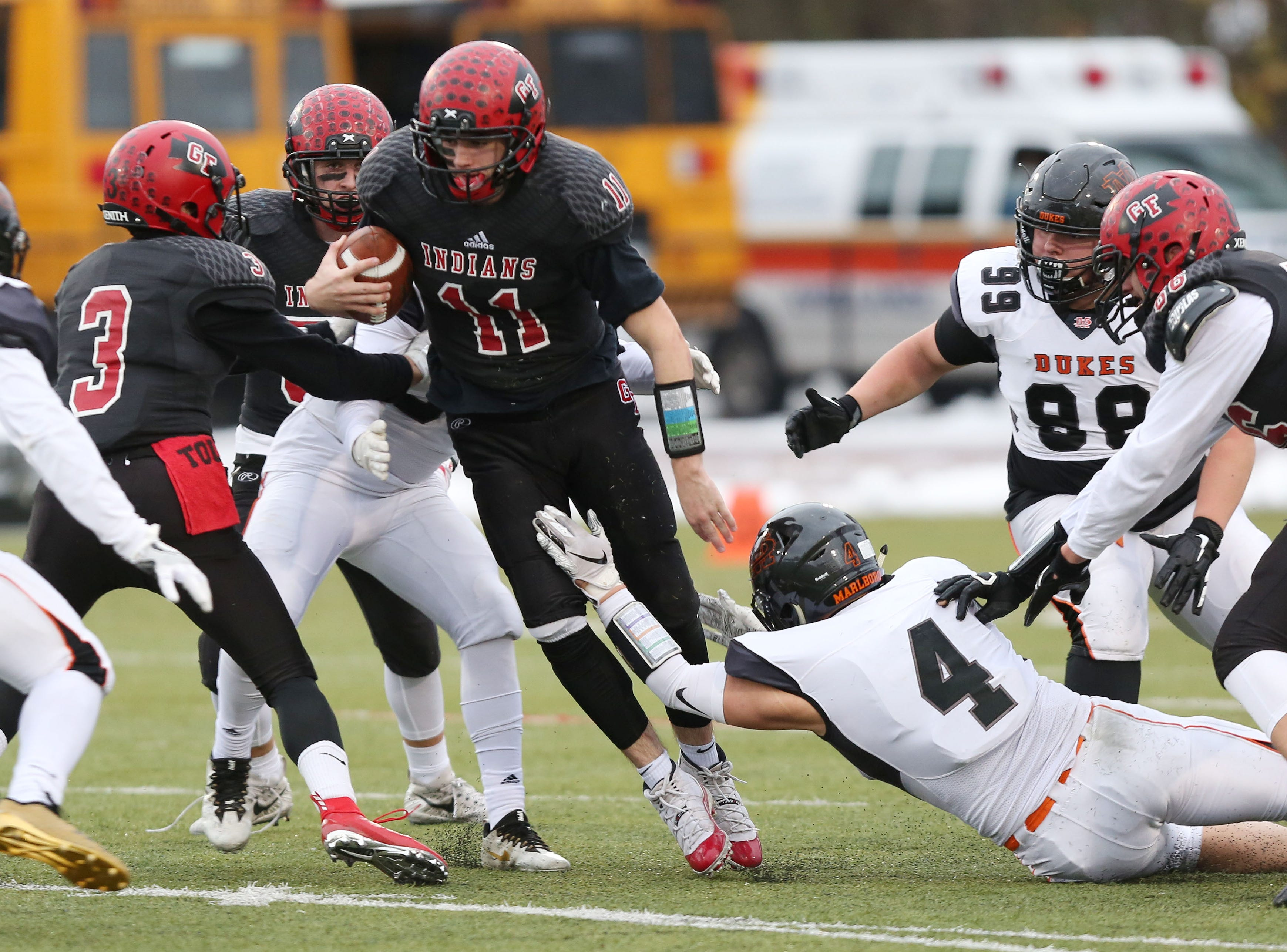 Glens Falls' Joe Girard looks for some running room in the Marlboro  defense during the state Class B semifinal game at Middletown High School Nov. 17, 2018.  Girard and the Indians face Batavia in Saturday's state championship game.