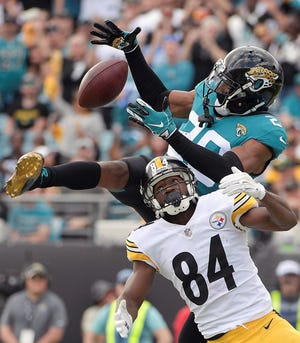 Jacksonville Jaguars cornerback Jalen Ramsey, top, intercepts a pass intended for Pittsburgh Steelers wide receiver Antonio Brown (84) in the end zone during the second half of an NFL football game, Sunday, Nov. 18, 2018, in Jacksonville, Fla. (AP Photo/Phelan M. Ebenhack)