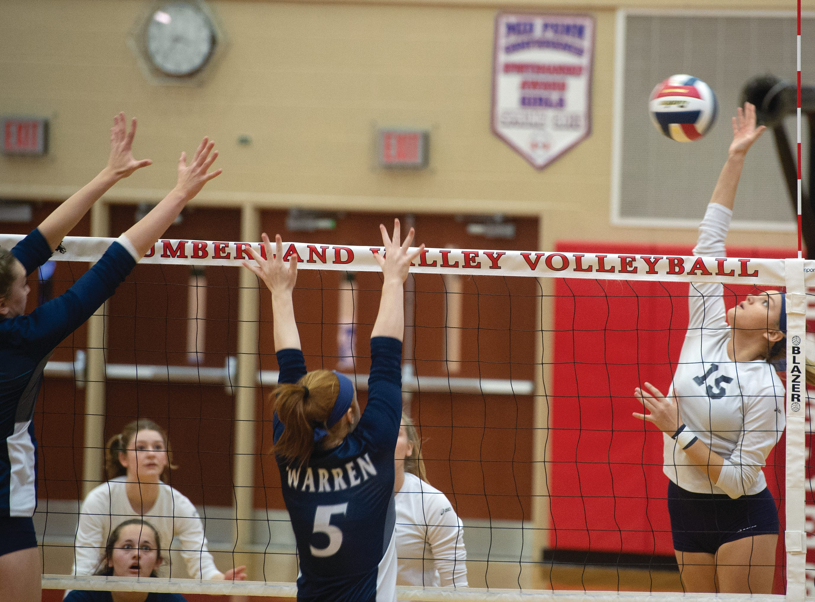 West York's Gianna Krinock goes up for a hit against Warren's double block Saturday in the PIAA Class 3A girls' volleyball championship. The Bulldogs won 3-0.