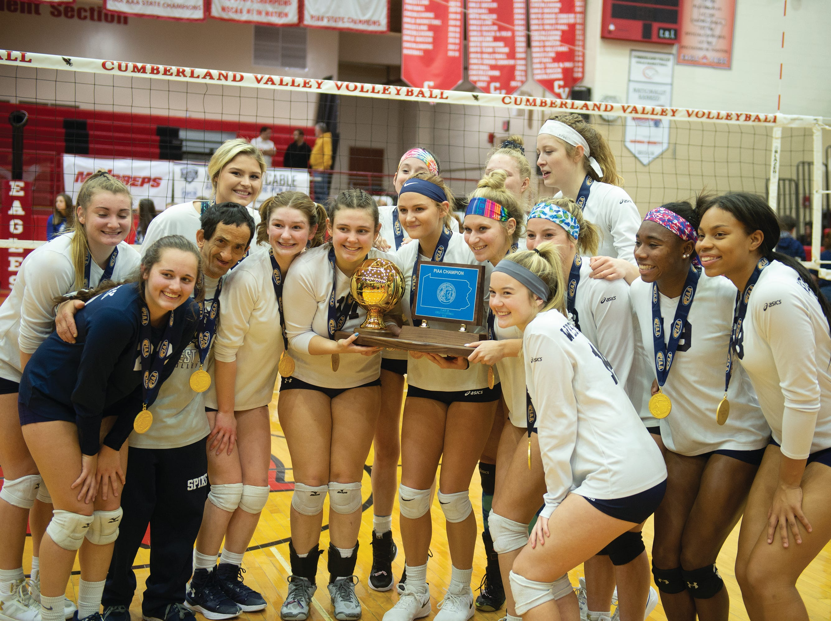 West York girls' volleyball team shows off its PIAA Class 3A championship trophy after defeating Warren on Saturday.