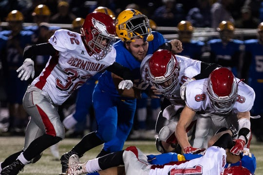 Middletown's Cole Senior (62) loses his helmet during the first half of the District 3 Class 3A championship game between Bermudian Springs and Middletown, Saturday, Nov. 17, 2018, at Cedar Crest High School. Middletown leads Bermudian Springs 28-6 at the half.