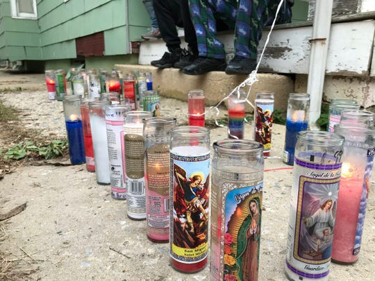 A memorial of candles set up in the 300 block of East Poplar Street in York, where police say Steven Scott, 18, was shot to death.