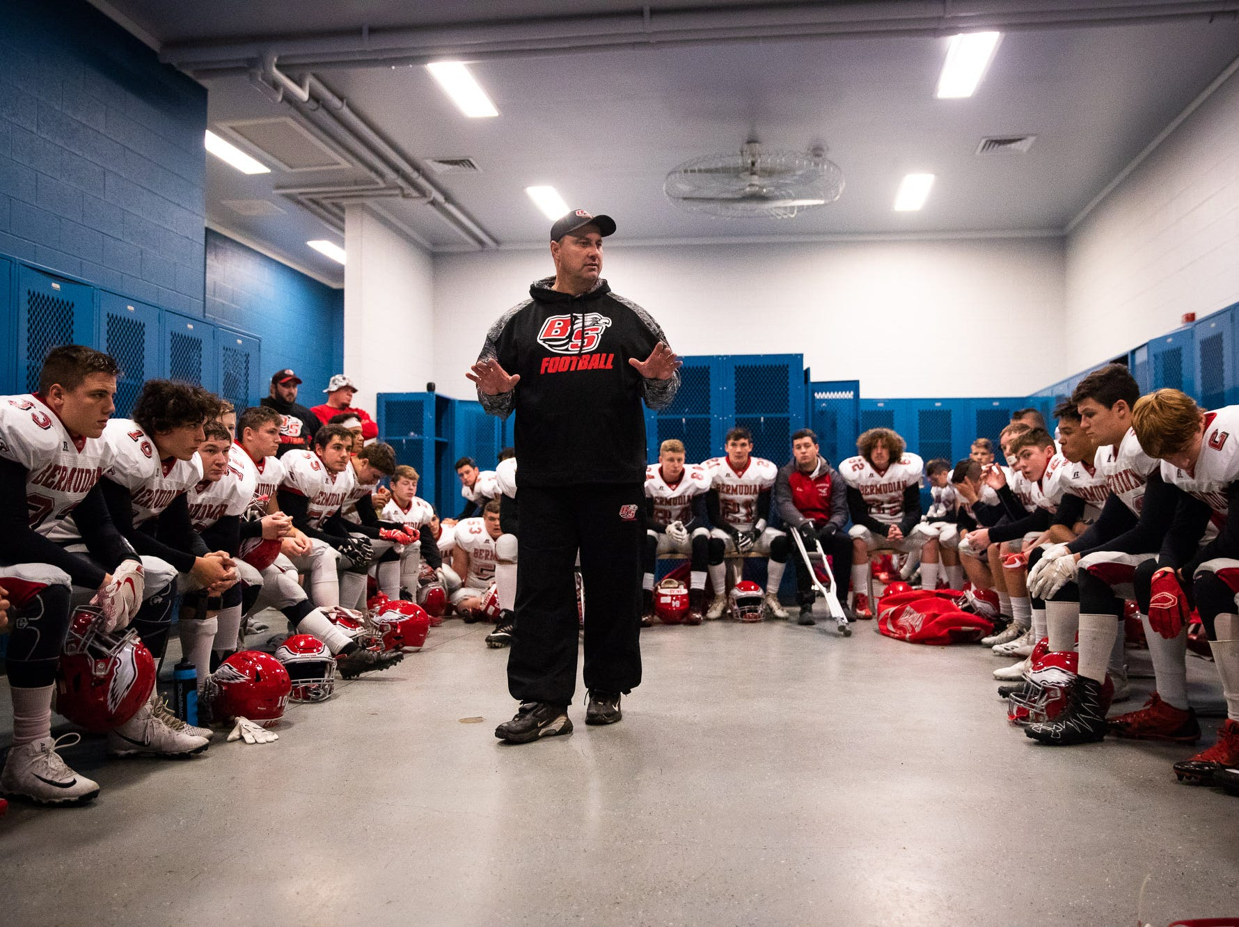 The Bermudian Springs Eagles listen to their head coach, Jon DeFoe, in the locker room before the first half of the District 3 Class 3A championship game between Bermudian Springs and Middletown, Saturday, Nov. 17, 2018, at Cedar Crest High School. Middletown leads Bermudian Springs 28-6 at the half.