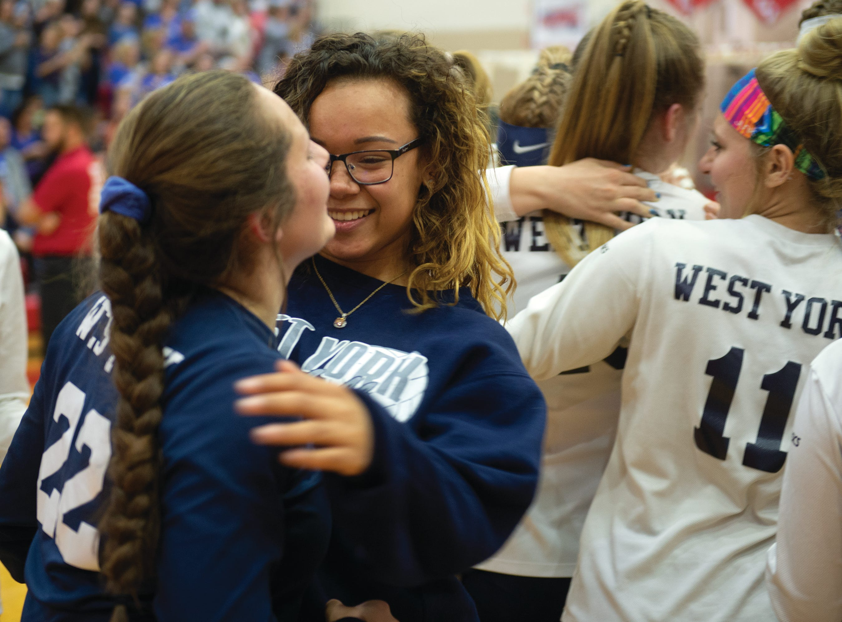 Libero Kambrie Hepler is congratulated after West York defeated Warren 3-0 Saturday to win the PIAA Class 3A girls' volleyball championship.