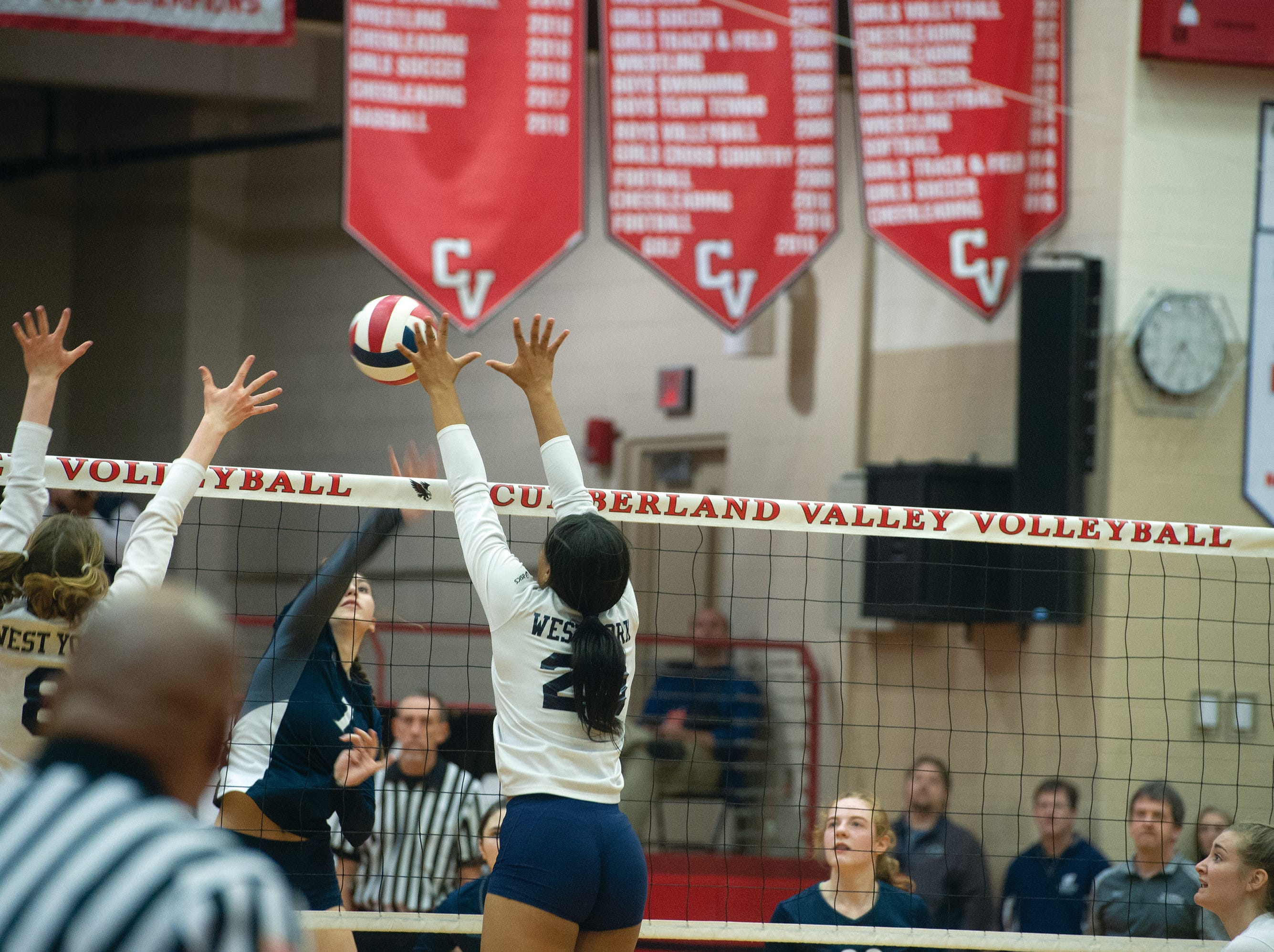 A Warren player tries to split the West York double block of Julia Rill (8) and Alayna Harris, but hits it right into Harris' hands Saturday in the third game of the PIAA Class 3A girls' volleyball championship. West York won the title in three games on Nov. 17, 2018 at Cumberland Valley High School.