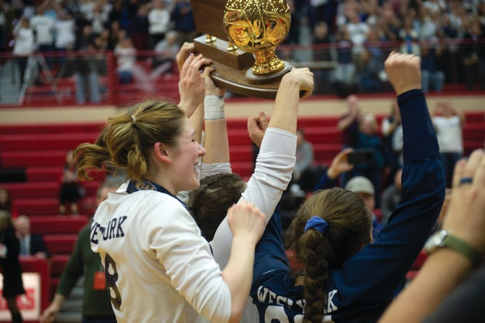 Julia Rill (8) and other West York seniors hold up the PIAA Class 3A girls' volleyball championship trophy after defeating Warren 3-0 on Saturday, Nov. 17, 2018 at Cumberland Valley High School.