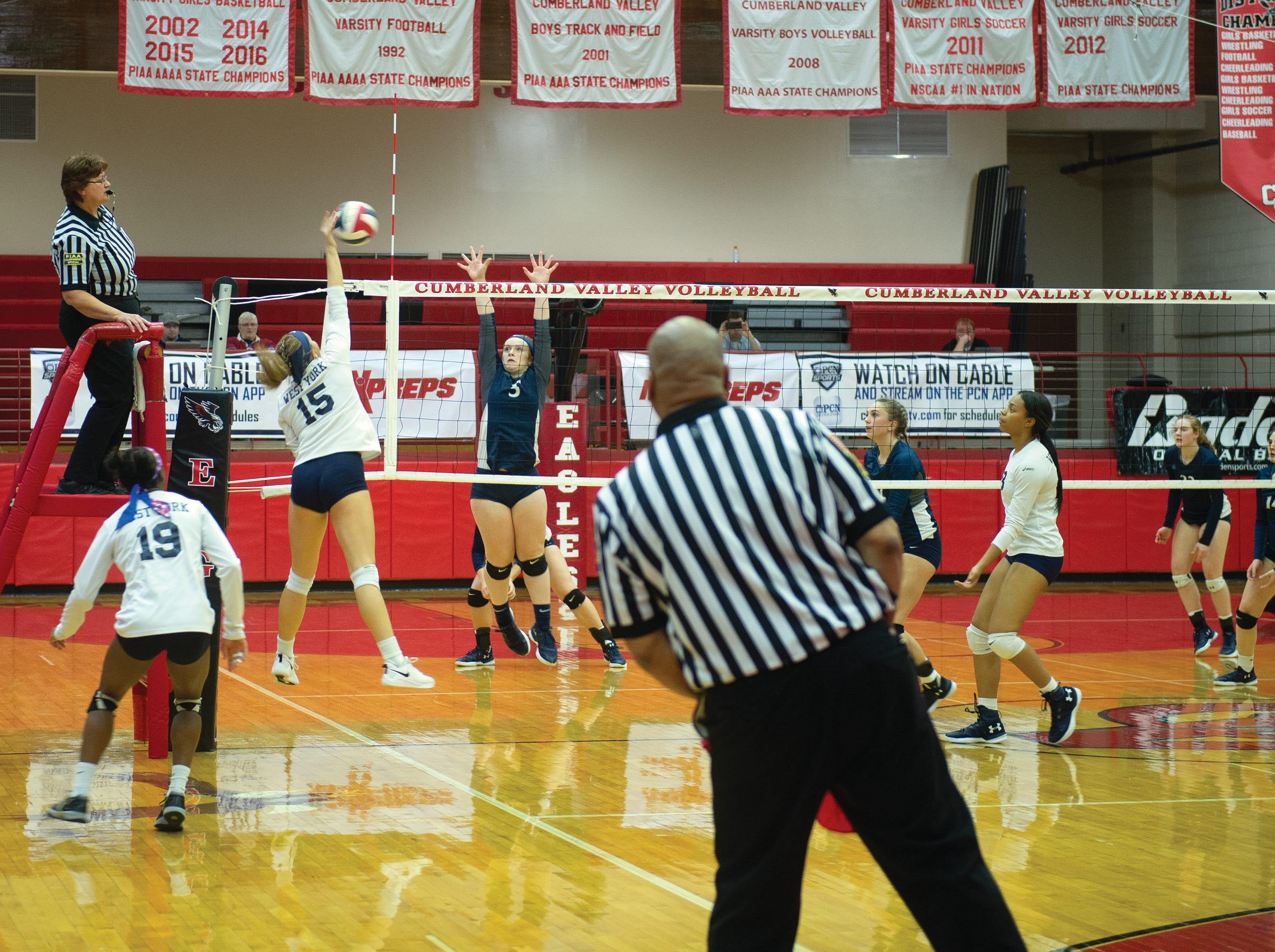 West York's Gianna Krinock goes up for a spike in the third game against Warren in the PIAA Class 3A girls' volleyball championship at Cumberland Valley High School. West York won 3-0.