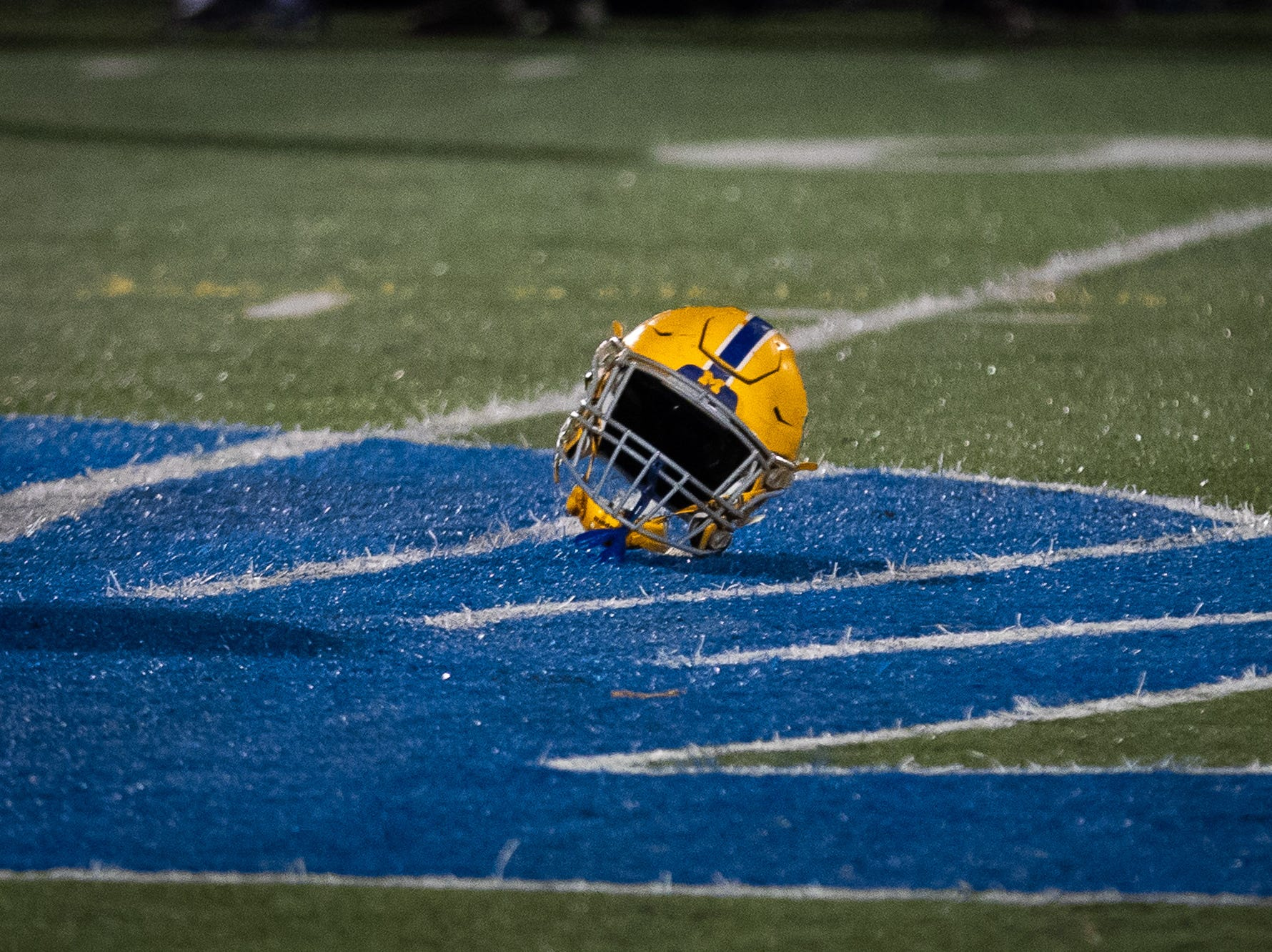 The lost helmet of Middletown's Cole Senior (62) sits on the field during the first half of the District 3 Class 3A championship game between Bermudian Springs and Middletown, Saturday, Nov. 17, 2018, at Cedar Crest High School. Middletown leads Bermudian Springs 28-6 at the half.