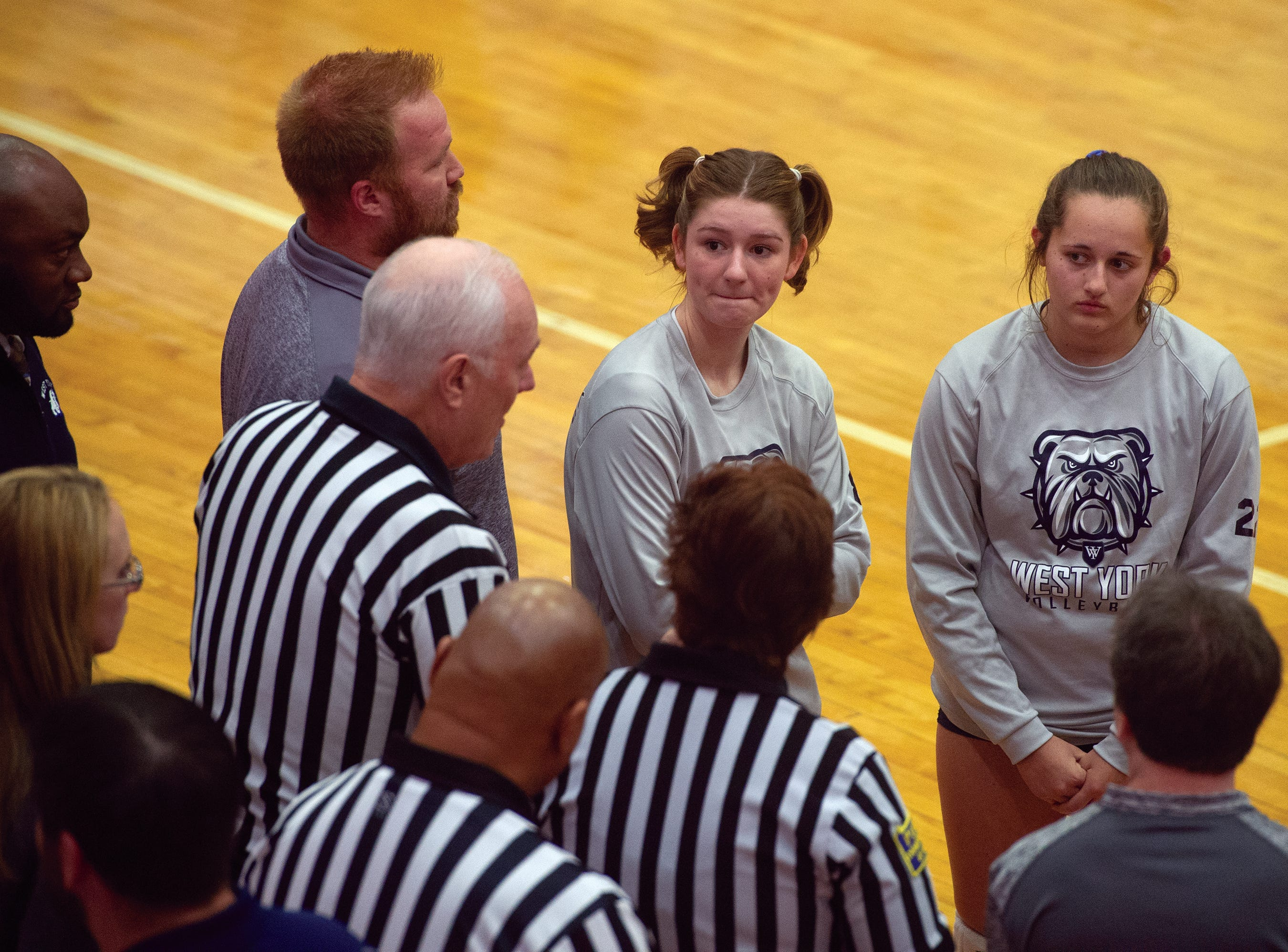 West York's captains listen to the officials before Saturday's PiAA Class 3A girls' volleyball championship at Cumberland Valley High School. The Bulldogs defeated Warren 3-0 for the state title.