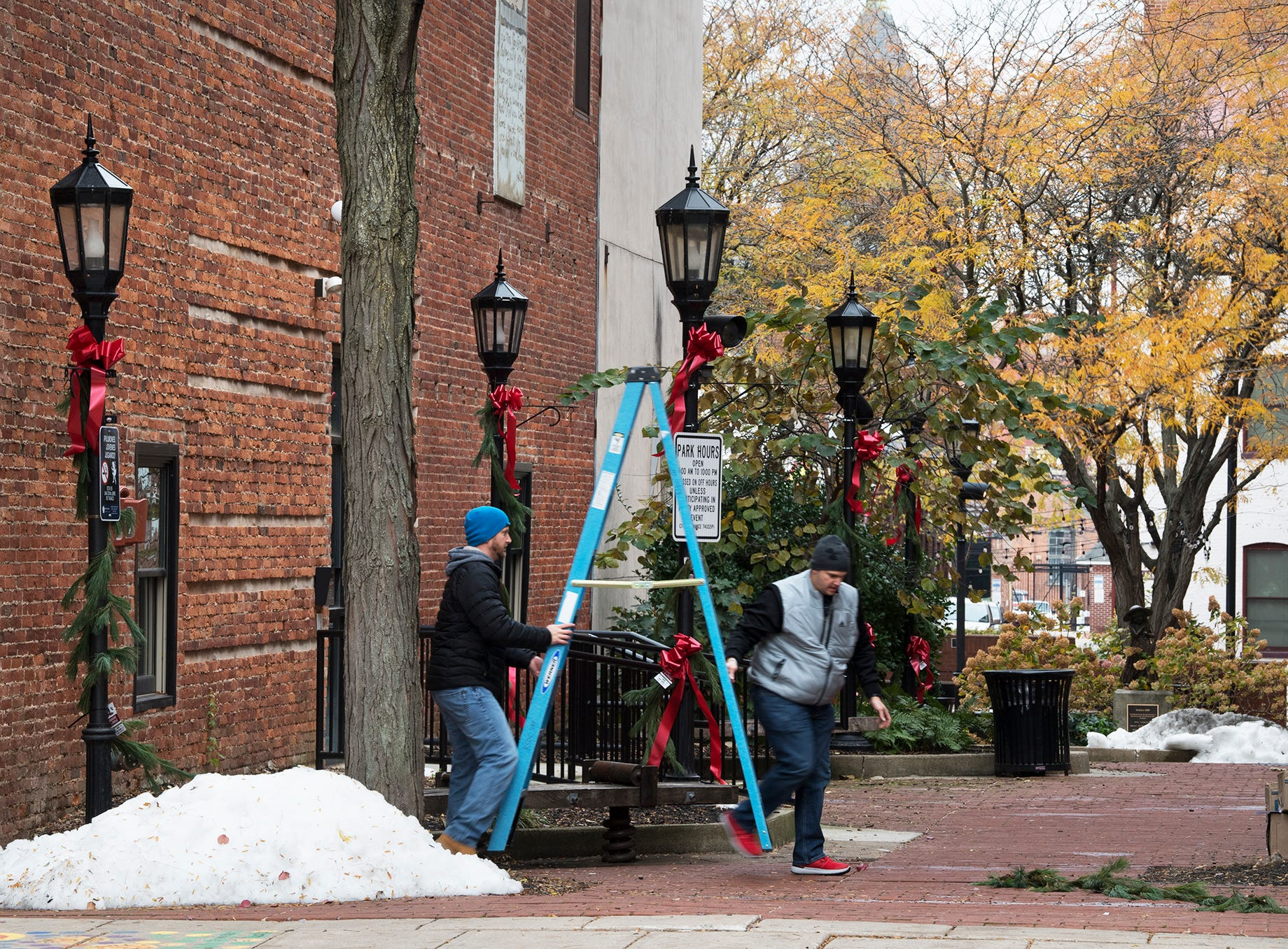 Greens are hung on Cherry Lane during the Hanging of the Greens around Continental Square in York on Sunday.