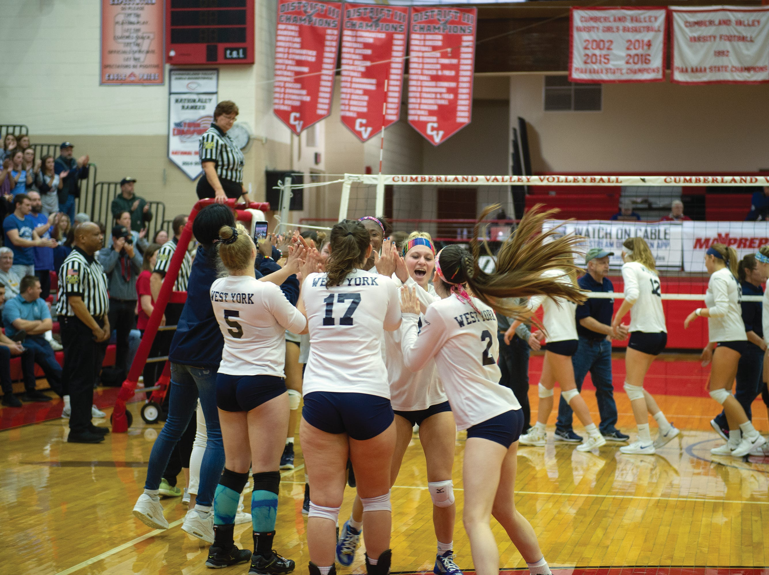 West York's celebration starts after the Bulldogs defeated Warren 3-0 to win the PIAA Class 3A girls' volleyball championship.