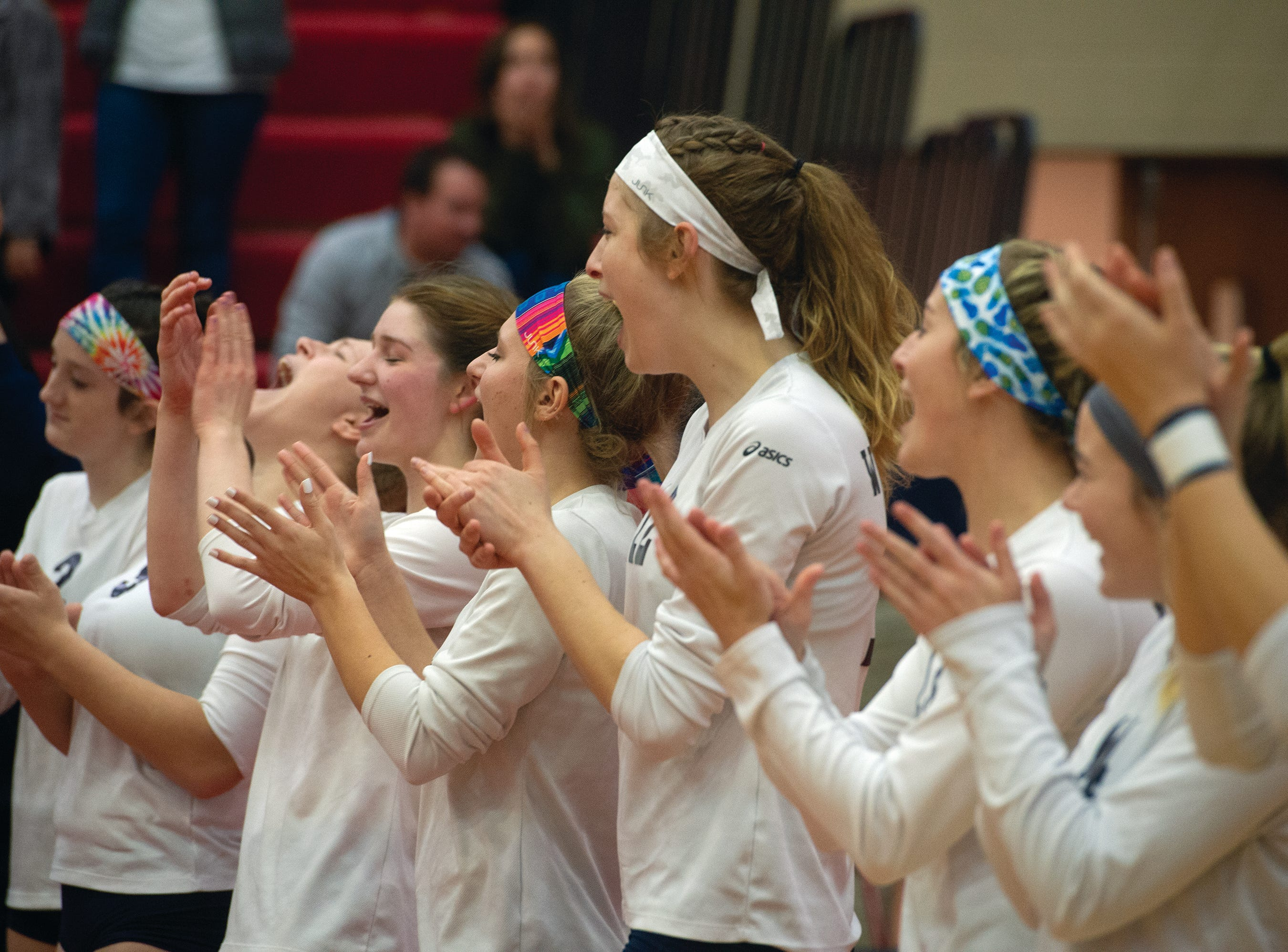 West York players celebrate as they wait for their PIAA Class 3A girls' volleyball gold medals Saturday.