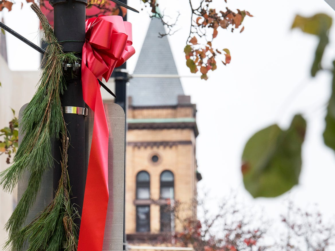 Decorated lampposts are on East Market Street during the Hanging of the Greens around Continental Square in York Sunday November 18, 2018.