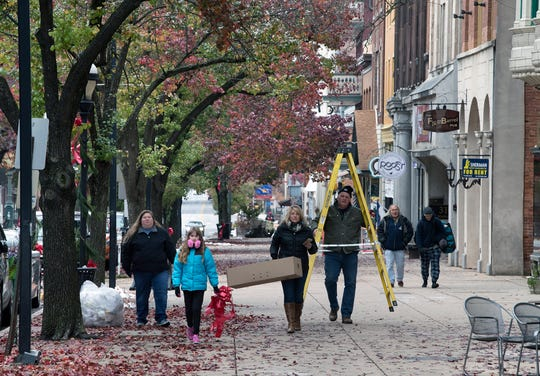 About 40 volunteers hung greens and bows along the downtown area during the Hanging of the Greens around Continental Square in York.