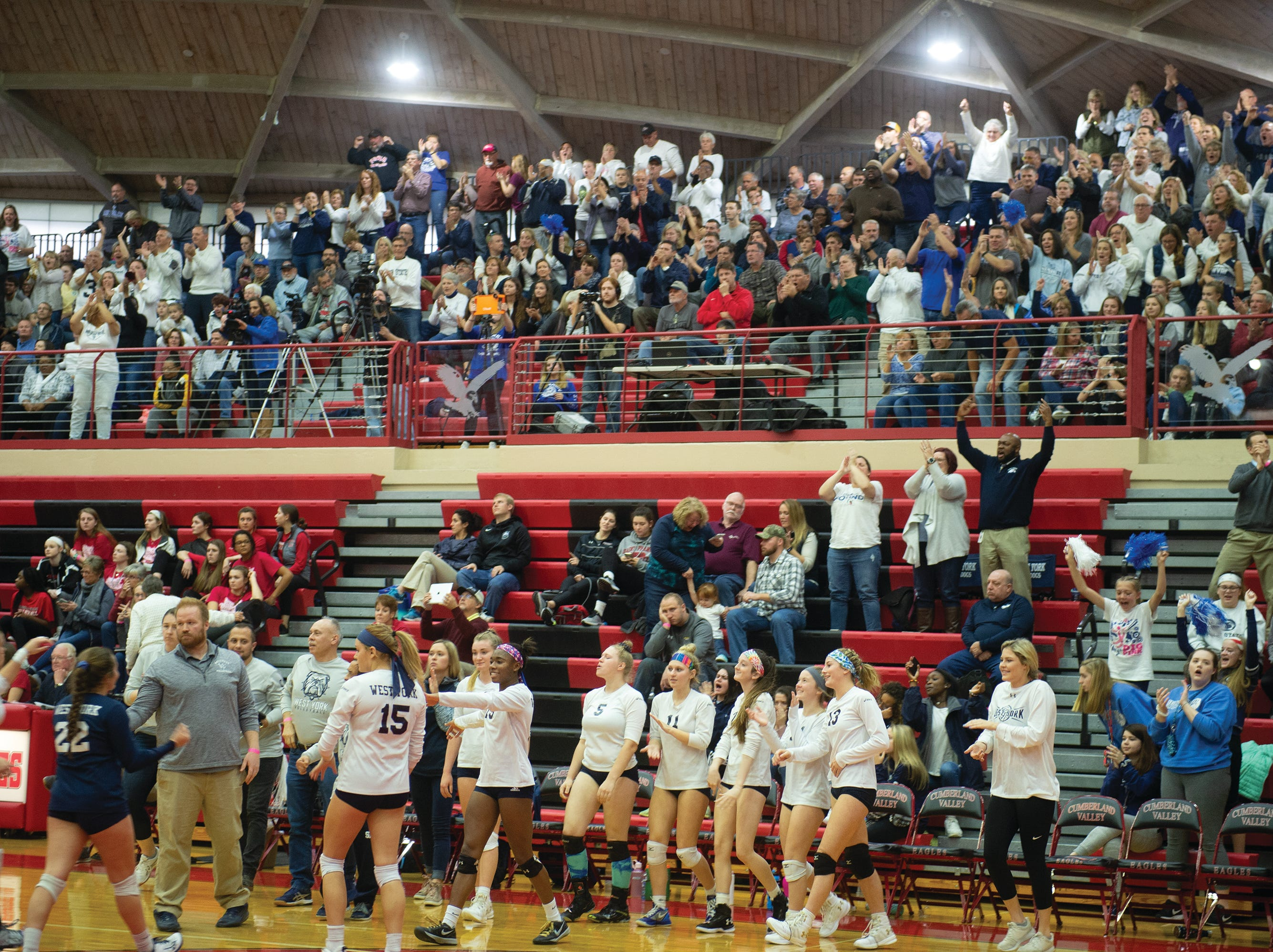 West York fans cheer as the Bulldogs come to the bench for the final timeout of Saturday's PIAA Class 3A girls' volleyball championship. West York defeated Warren 3-0.