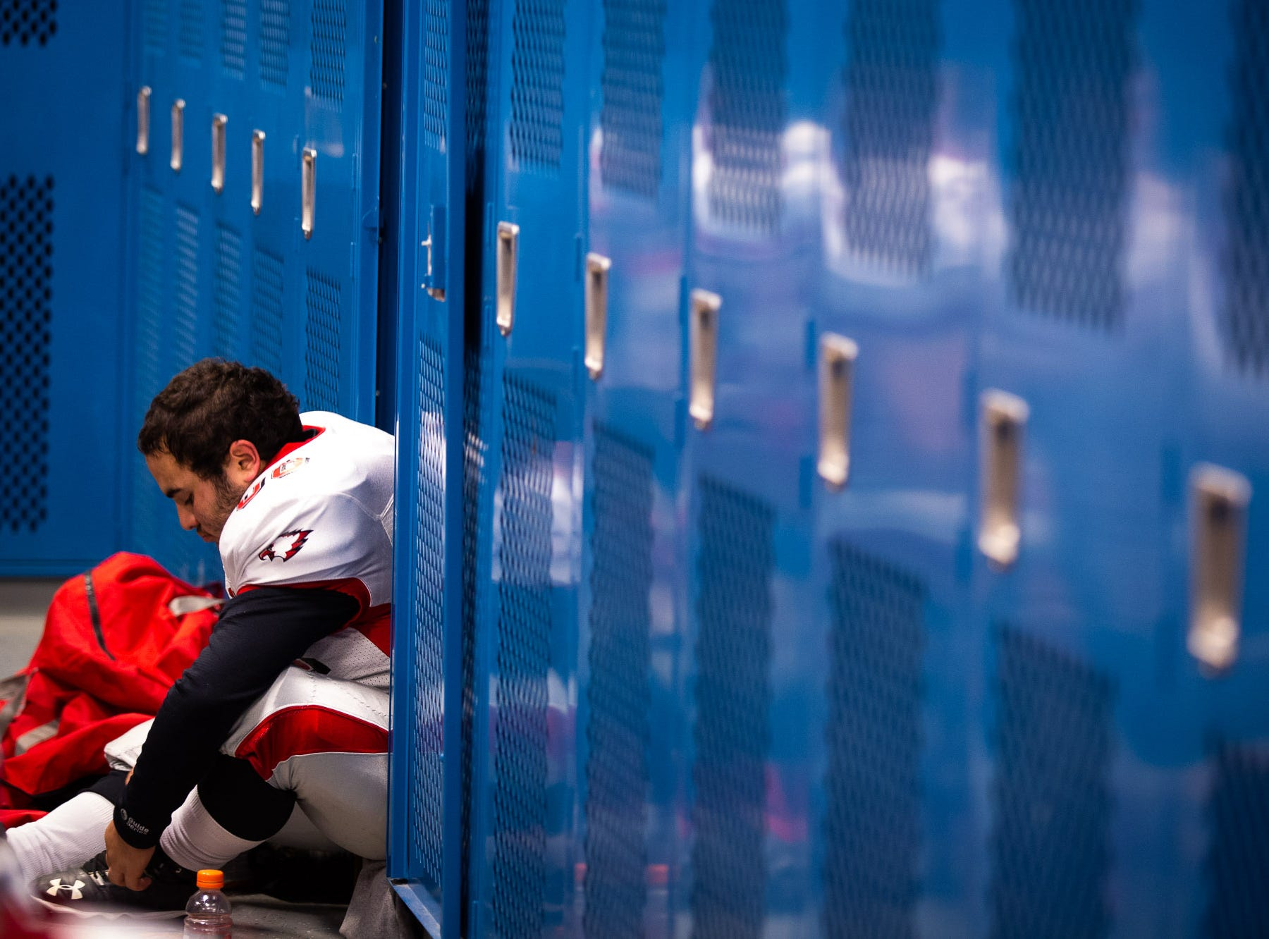 Bermudian Springs' Josh Wenrich (66) sits in the locker room before the District 3 Class 3A championship game between Bermudian Springs and Middletown, Saturday, Nov. 17, 2018, at Cedar Crest High School. Middletown leads Bermudian Springs 28-6 at the half.