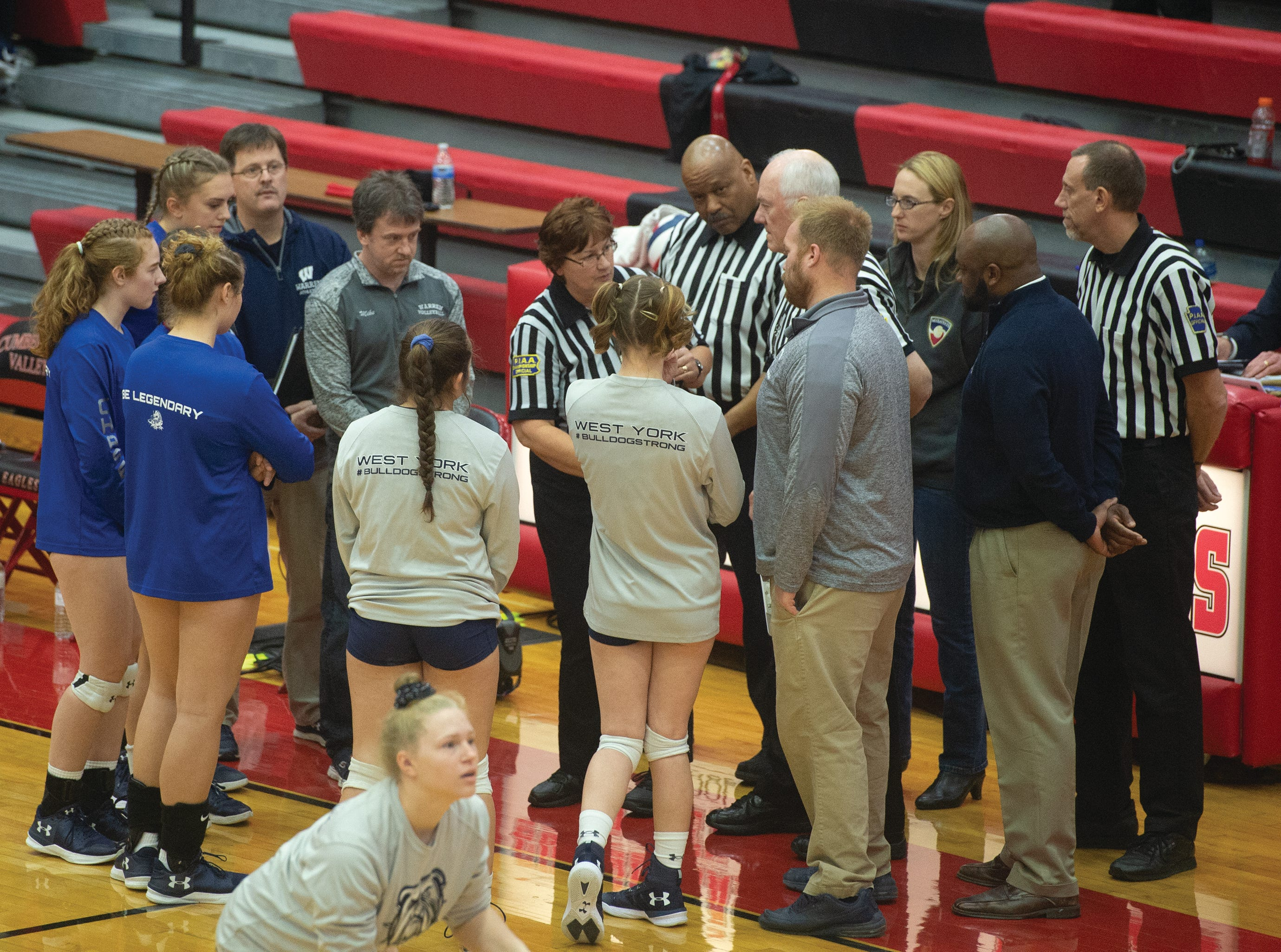 West York and Warren captains and coaches meet with officials ahead of the PiAA Class 3A girls' volleyball championship Saturday, Nov. 17, 2018 at Cumberland Valley High School.