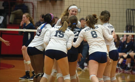 West York players celebrate one of the final points of their PIAA Class 3A girls' volleyball championship Saturday, Nov. 17, 2018 over Warren.