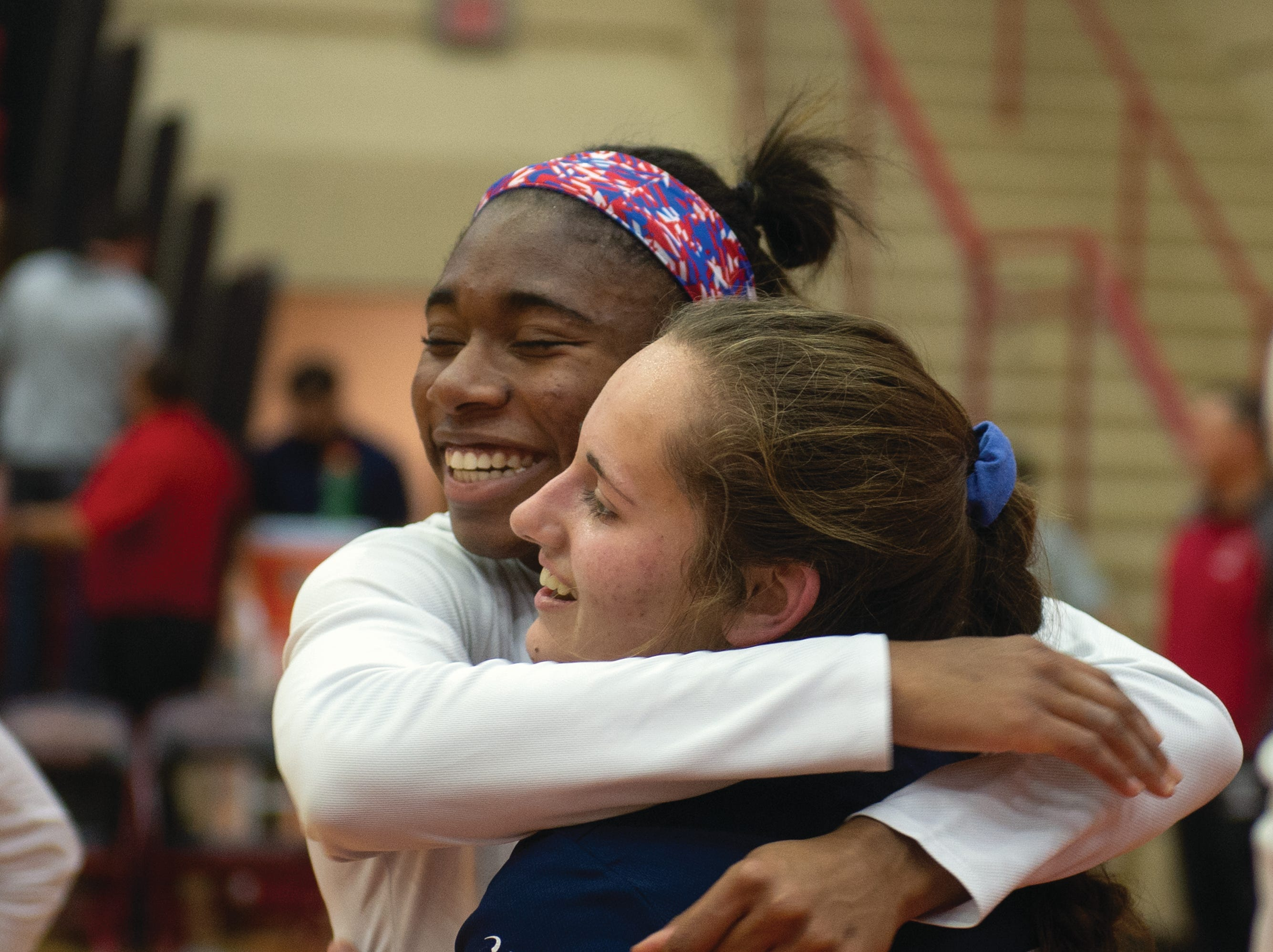 Tesia Thomas and Kambrie Hepler hug after West York defeated Warren 3-0 Saturday to win the PIAA Class 3A girls' volleyball title.