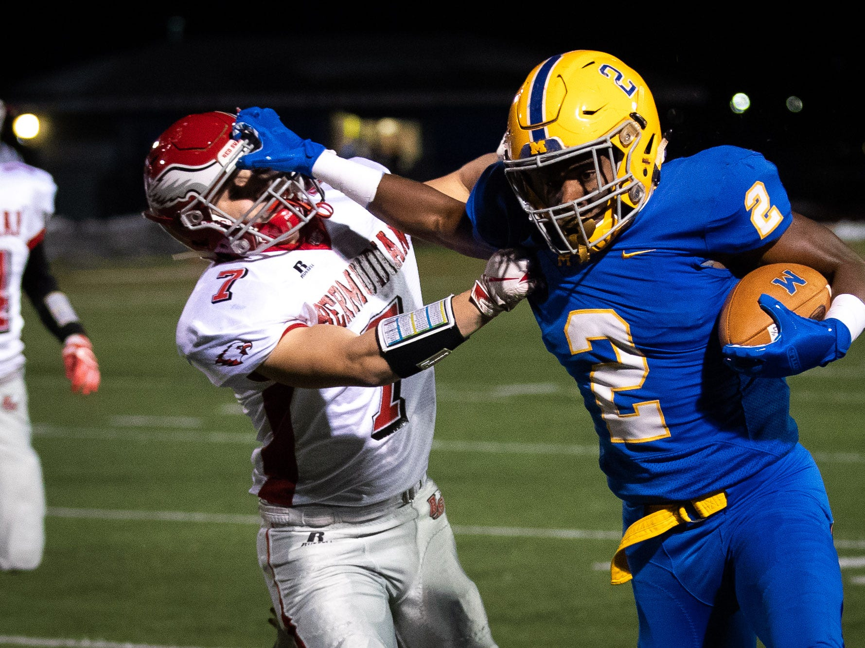 Middletown's Richie Sykes (2) stiff-arms Bermudian Springs' Matt Zelenski (7) during the first half of the District 3 Class 3A championship game between Bermudian Springs and Middletown, Saturday, Nov. 17, 2018, at Cedar Crest High School. Middletown leads Bermudian Springs 28-6 at the half.
