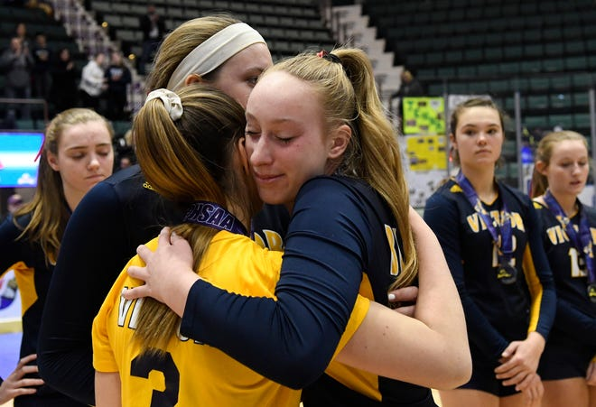 Victor seniors Kate Simplicio, Ally McFadden, and Makenzie Bills embrace following their loss in the Class AA state final against Long Beach on Sunday in Glens Falls