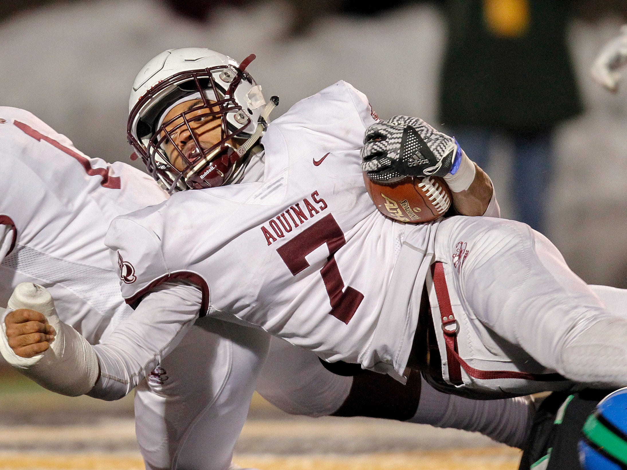 Aquinas' Ulysees Russell paves the way for teammate Caron Robinson against Cicero-North for a touchdown in the second quarter at Union-Endicott High School during state semifinals. Saturday, November 17, 2018.