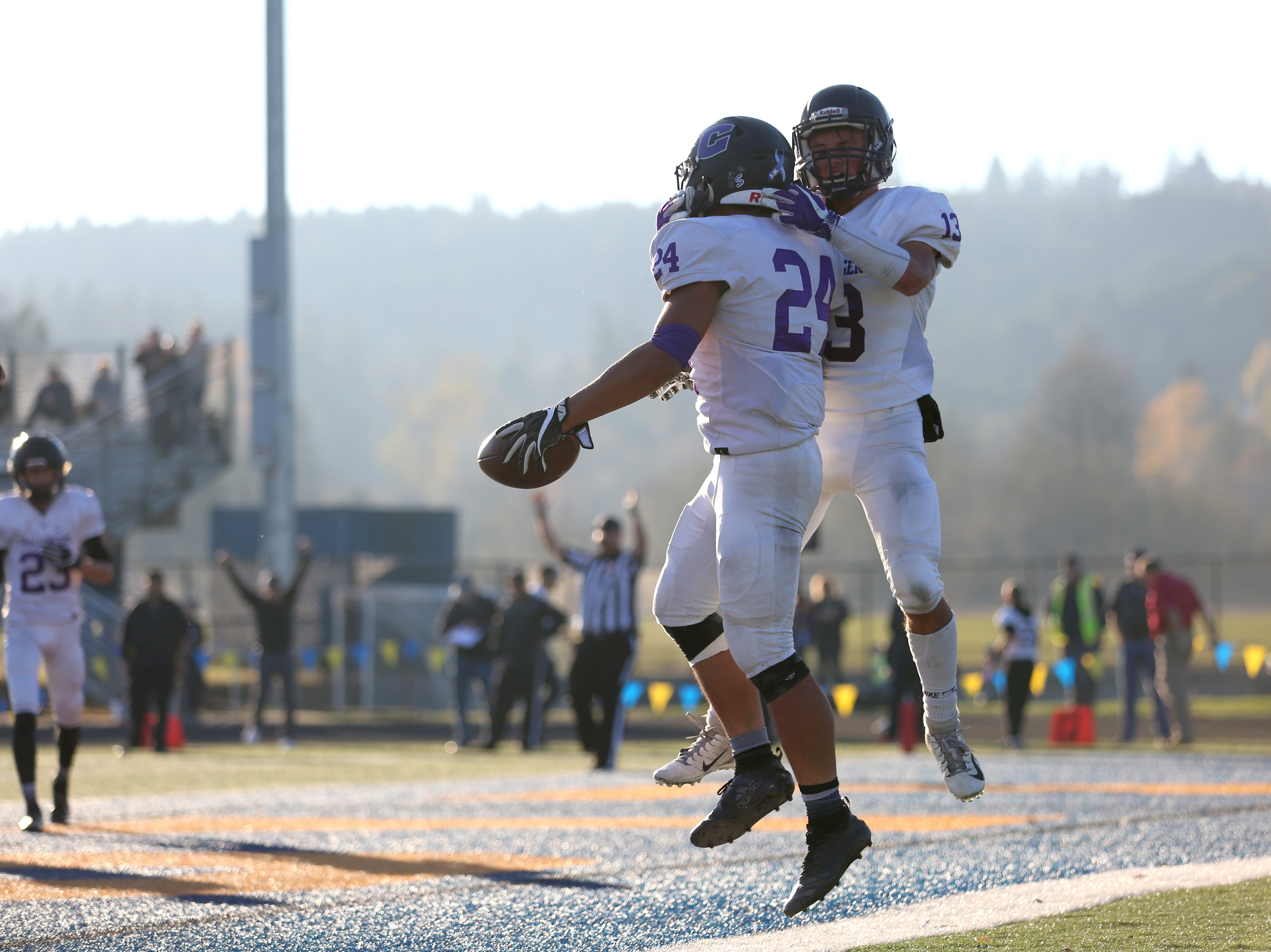 Cascade Christian celebrates during the OSAA 3A semifinal Amity vs Cascade Christian football game on Saturday, Nov. 17, 2018 in Cottage Grove.