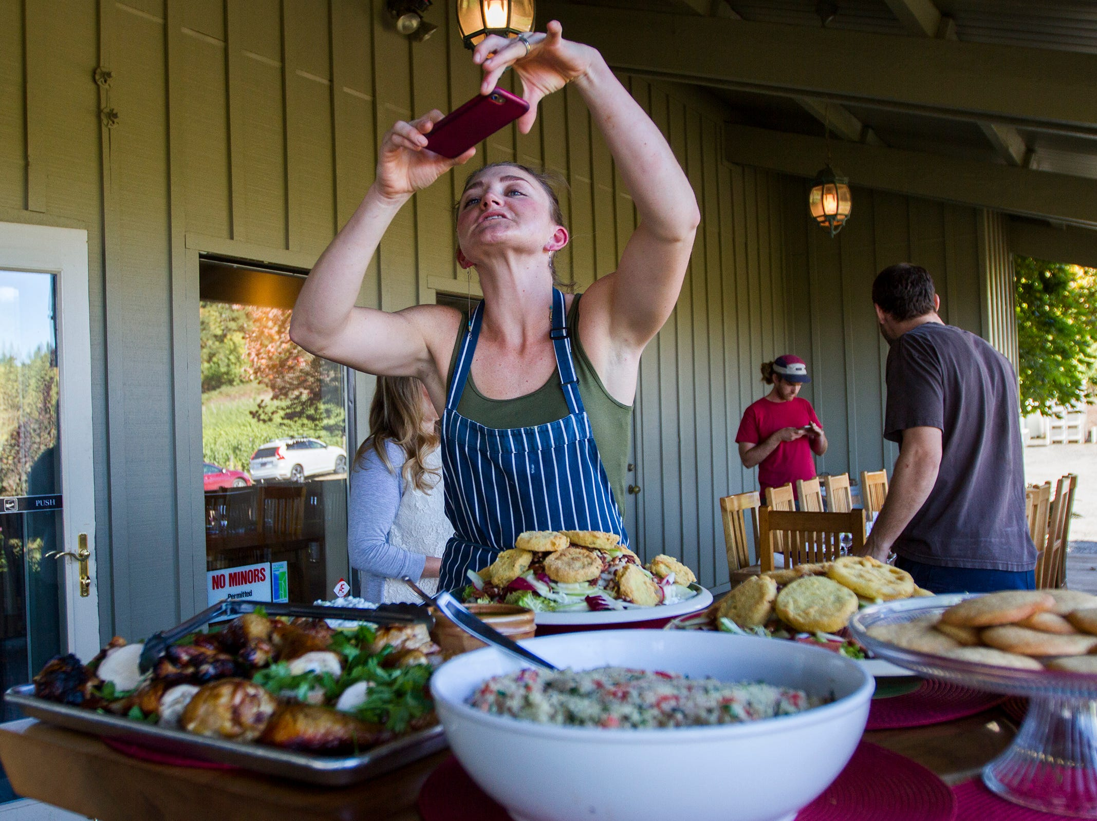 Cristom Vineyards chef Kat LeSueur takes a photo of her prepared meals before harvest workers serve themselves at Cristom Winery on Tuesday, Oct. 2, 2018. During harvest season Willamette Valley wineries will sometimes hire a chef to cook for a crew working 12-hour days.