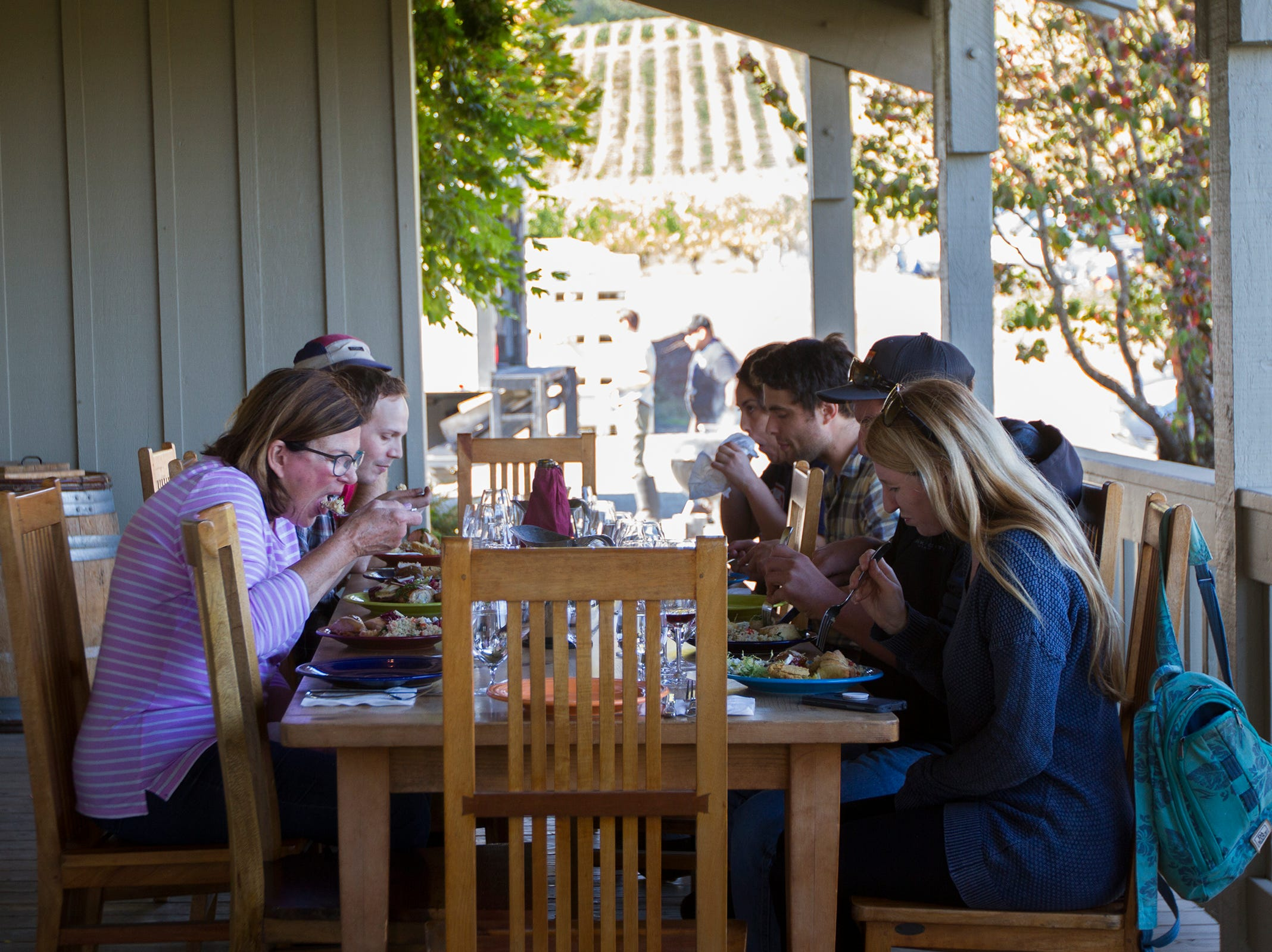 Cristom Winery vineyard workers enjoy a family meal on Tuesday, Oct. 2, 2018. During harvest season Willamette Valley wineries will sometimes hire a chef to cook for a crew working 12-hour days.