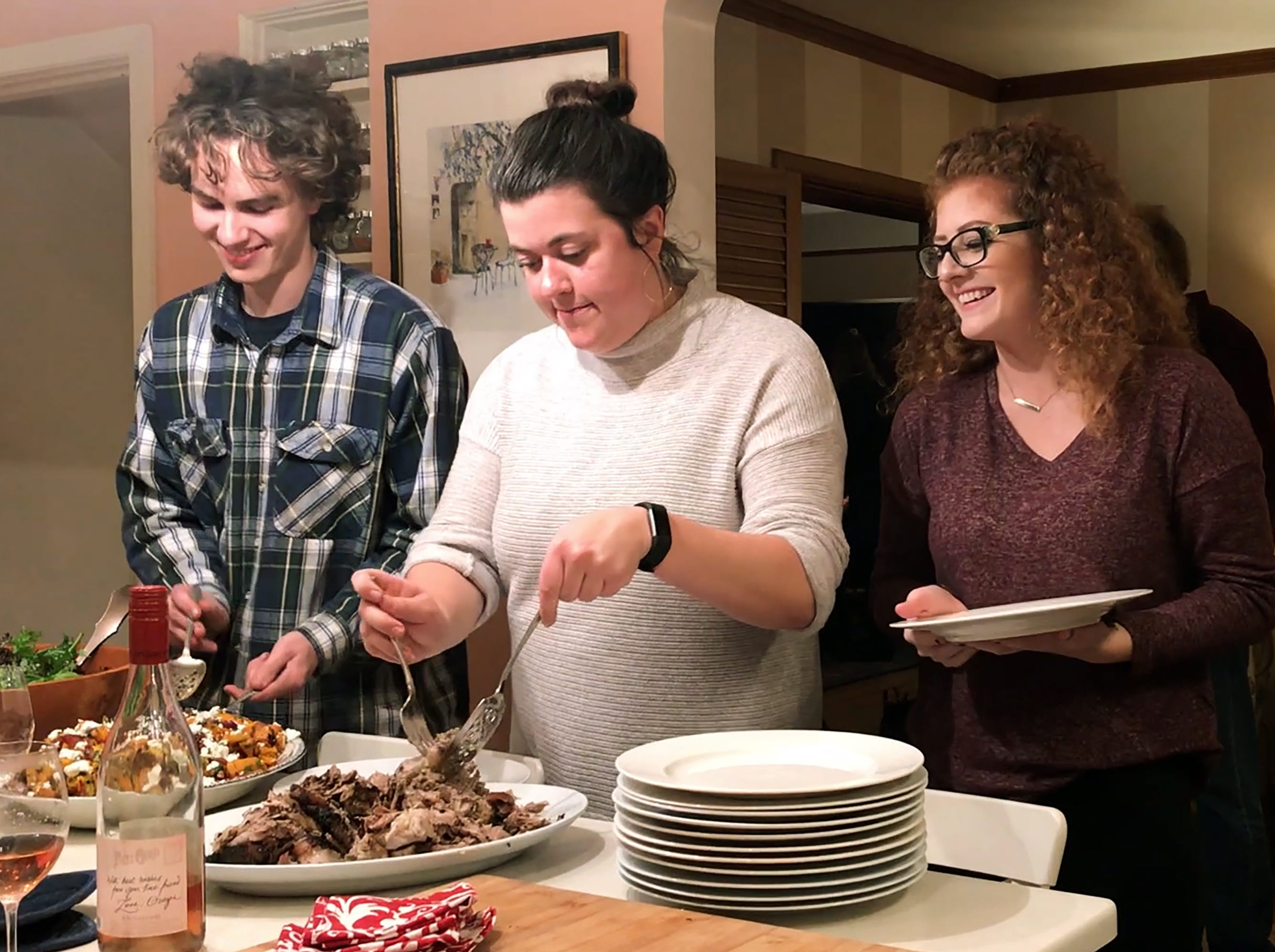 Dinner guests serve themselves a dinner prepared by R. Stuart & Co. cofounder, Maria Stuart on Nov. 7, 2018, in McMinnville.