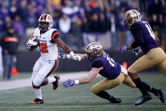 Nov 17, 2018; Seattle, WA, USA; Oregon State Beavers running back Jermar Jefferson (22) rushes against the Washington Huskies during the third quarter at Husky Stadium. Mandatory Credit: Jennifer Buchanan-USA TODAY Sports