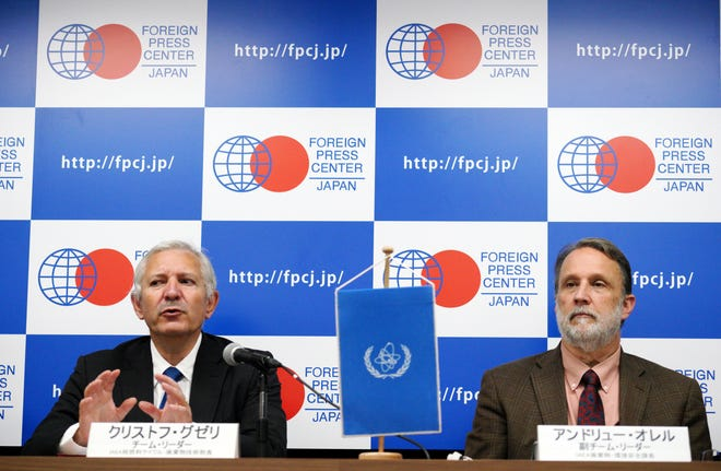 International Atomic Energy Agency (IAEA) team leader Christophe Xerri, left, Director of the IAEA's Division of Nuclear Fuel Cycle and Waste Technology, and Andrew Orrell, right, Section Head of the IAEA's Waste and Environmental Safety Section, attend during a press conference on a review Japan's decommissioning work at Fukushima Daiichi Site in Tokyo Tuesday, Nov. 13, 2018. Experts from the International Atomic Energy Agency have urged the operator of Japan's tsunami-wrecked Fukushima nuclear plant to urgently come up with a plan to dispose of massive amounts of radioactive water stored in tanks on the compound.