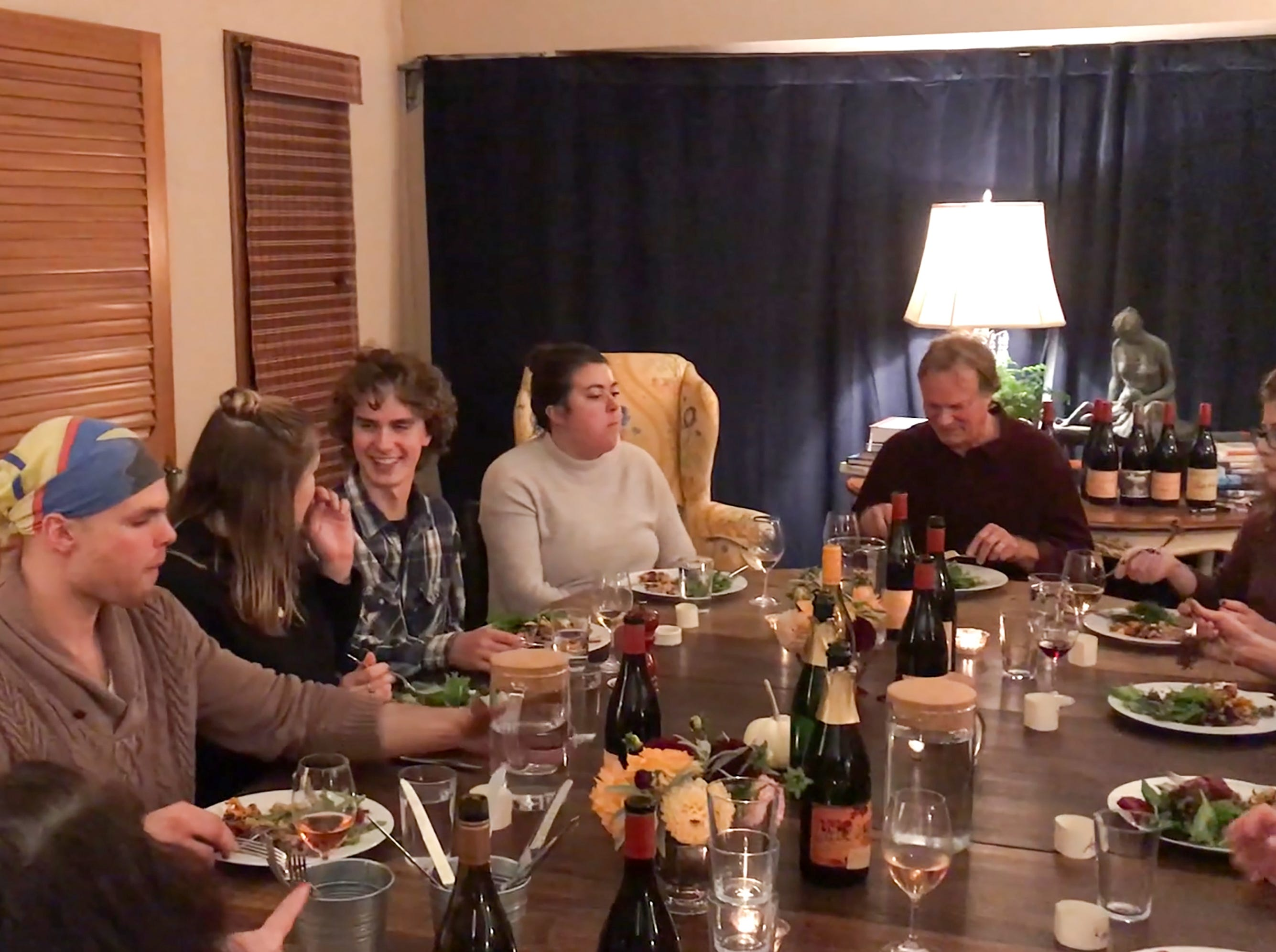R. Stuart & Co. winery harvest workers enjoy a dinner prepared by Maria Stuart on Nov. 7, 2018, in McMinnville. Each guest gets a napkin ring with their name on it.