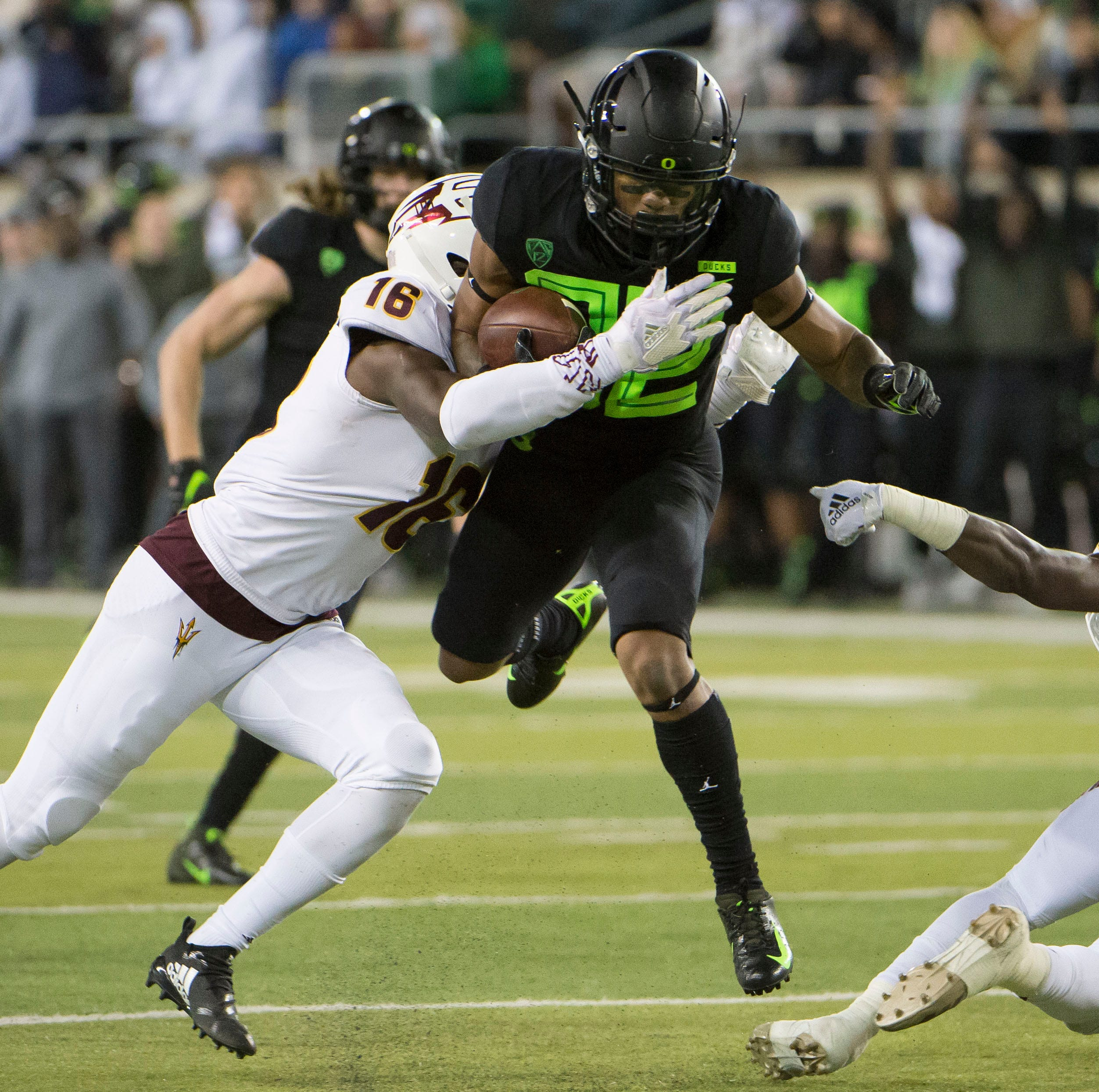 Nov 17, 2018; Eugene, OR, USA; Oregon Ducks wide receiver Justin Collins (82) picks up a first down during the first half  tackled by Arizona State Sun Devils safety Aashari Crosswell (16) at Autzen Stadium. Mandatory Credit: Troy Wayrynen-USA TODAY Sports