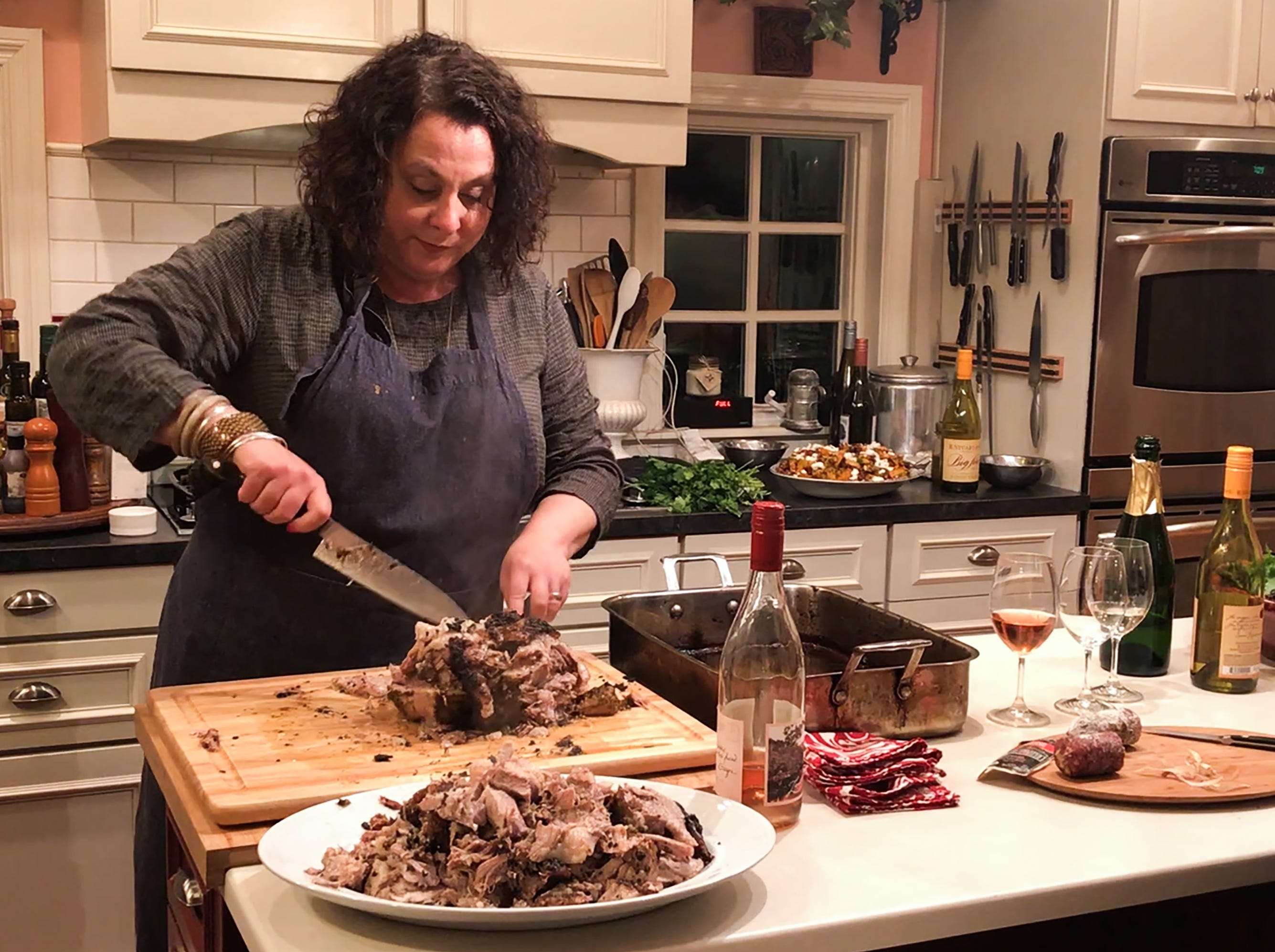 R. Stuart & Co. cofounder Maria Stuart prepares a pork roast for a dinner she hosted on Nov. 7, 2018, in McMinnville.