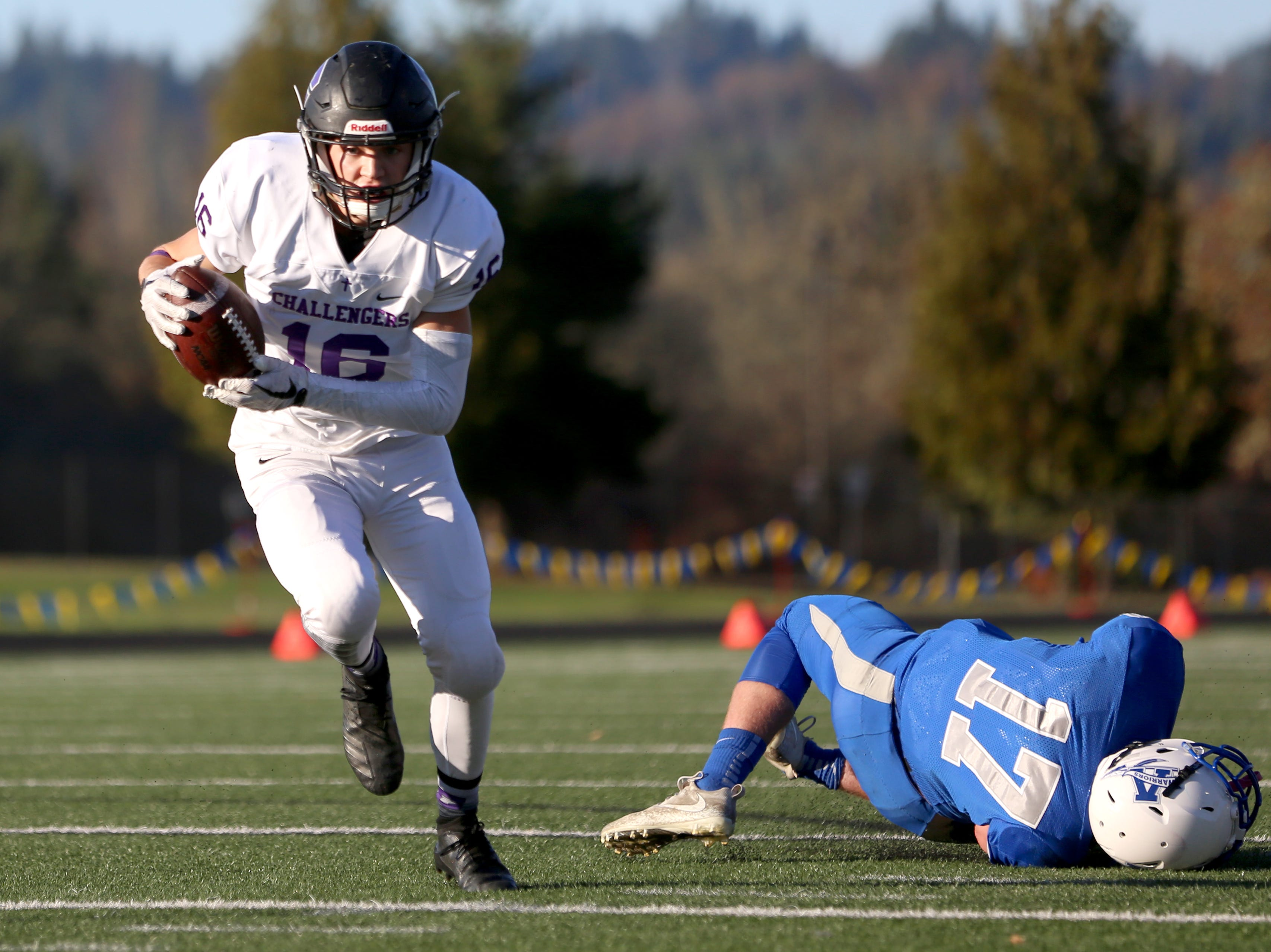 Cascade Christian's Cade Sample (16) rushes during the OSAA 3A semifinal Amity vs Cascade Christian football game on Saturday, Nov. 17, 2018 in Cottage Grove.