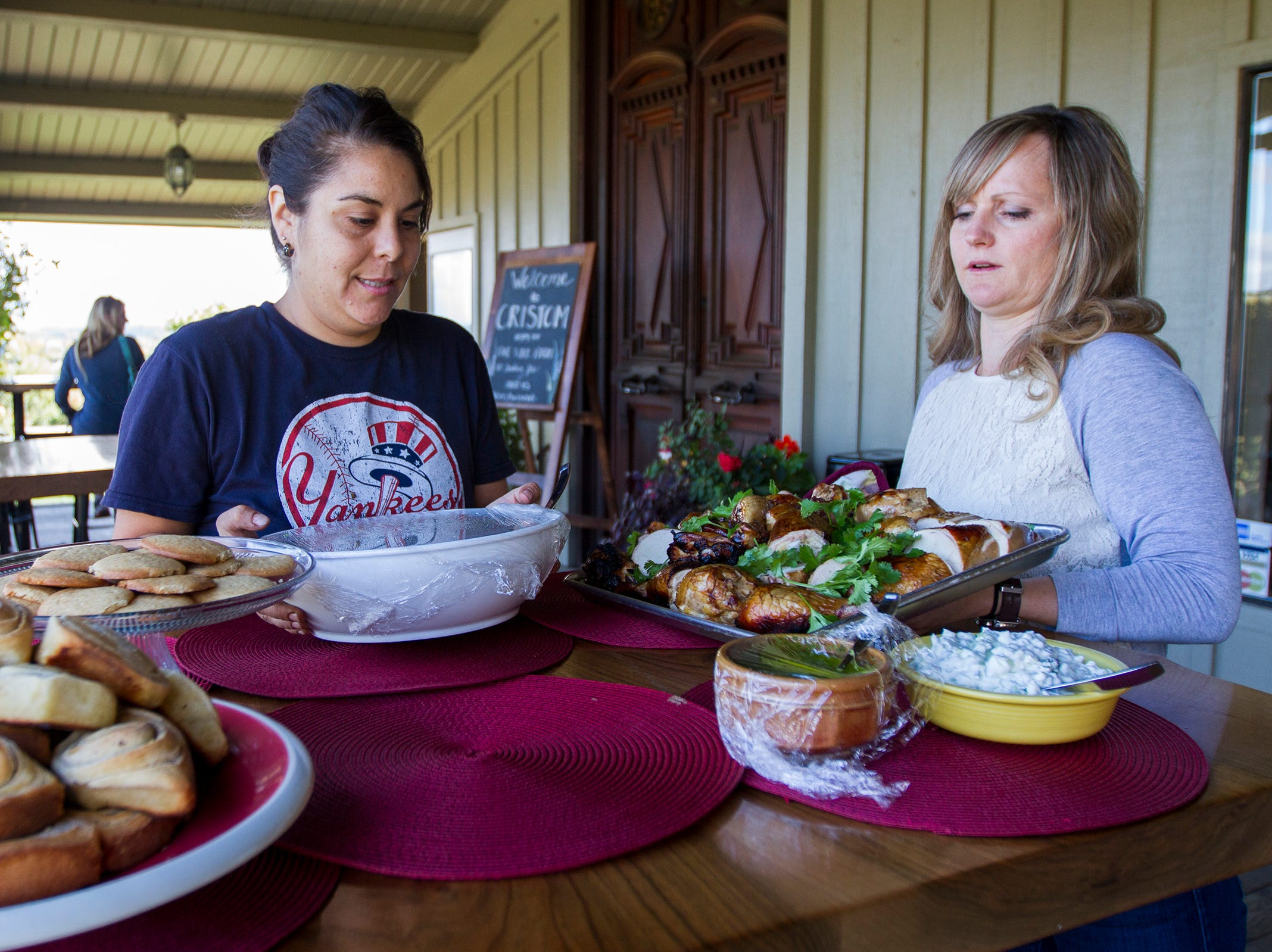 Cristom Winery harvest workers help set up a table of food on Tuesday, Oct. 2, 2018. During harvest season Willamette Valley wineries will sometimes hire a chef to cook for a crew working 12-hour days.