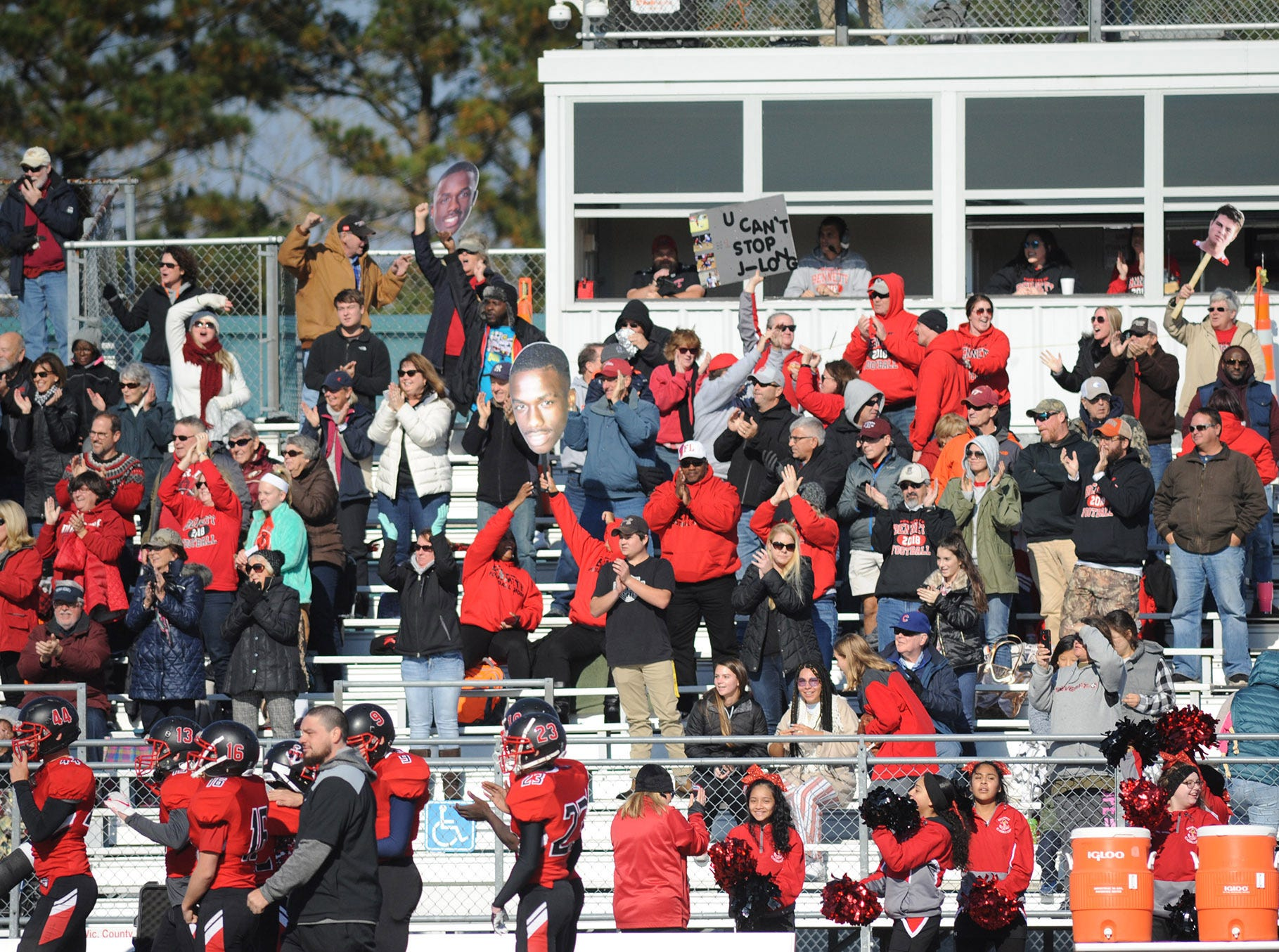 Bennett fans cheer after a touchdown during JMB's playoffs game vs. Chesapeake  at County Stadium on Saturday.