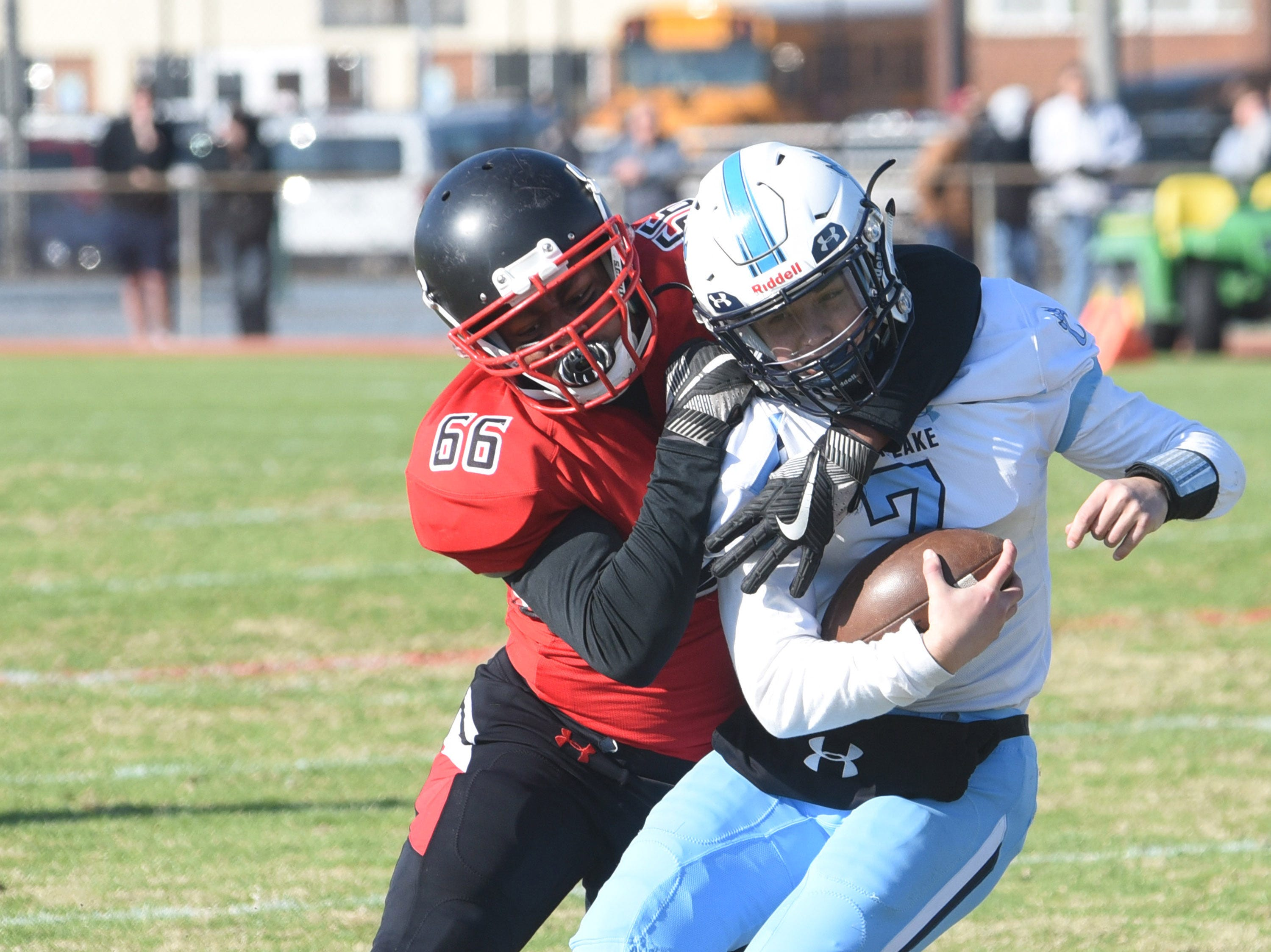 Bennett's Brian Duperval sacks Chesapeake's quarterback Dylan Young in the first half during James M. Bennett'st to Chesapeake 36-21 in the State Regional playoff game at County Stadium on Saturday.