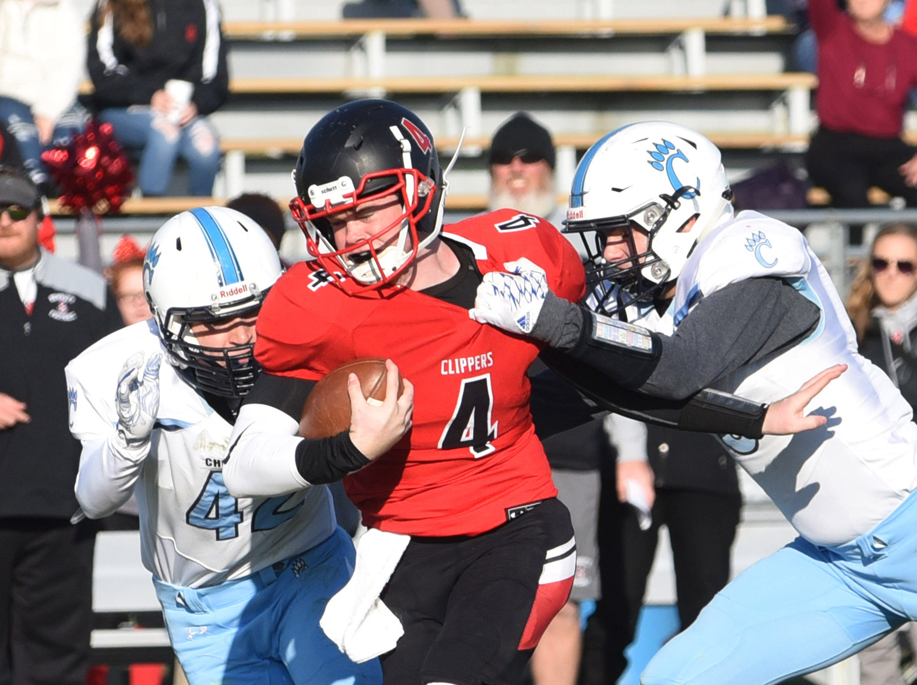 Bennett's Brandon Scholl runs with the ball in the second half during James M. Bennett's playoff game vs. Chesapeake at County Stadium on Saturday.