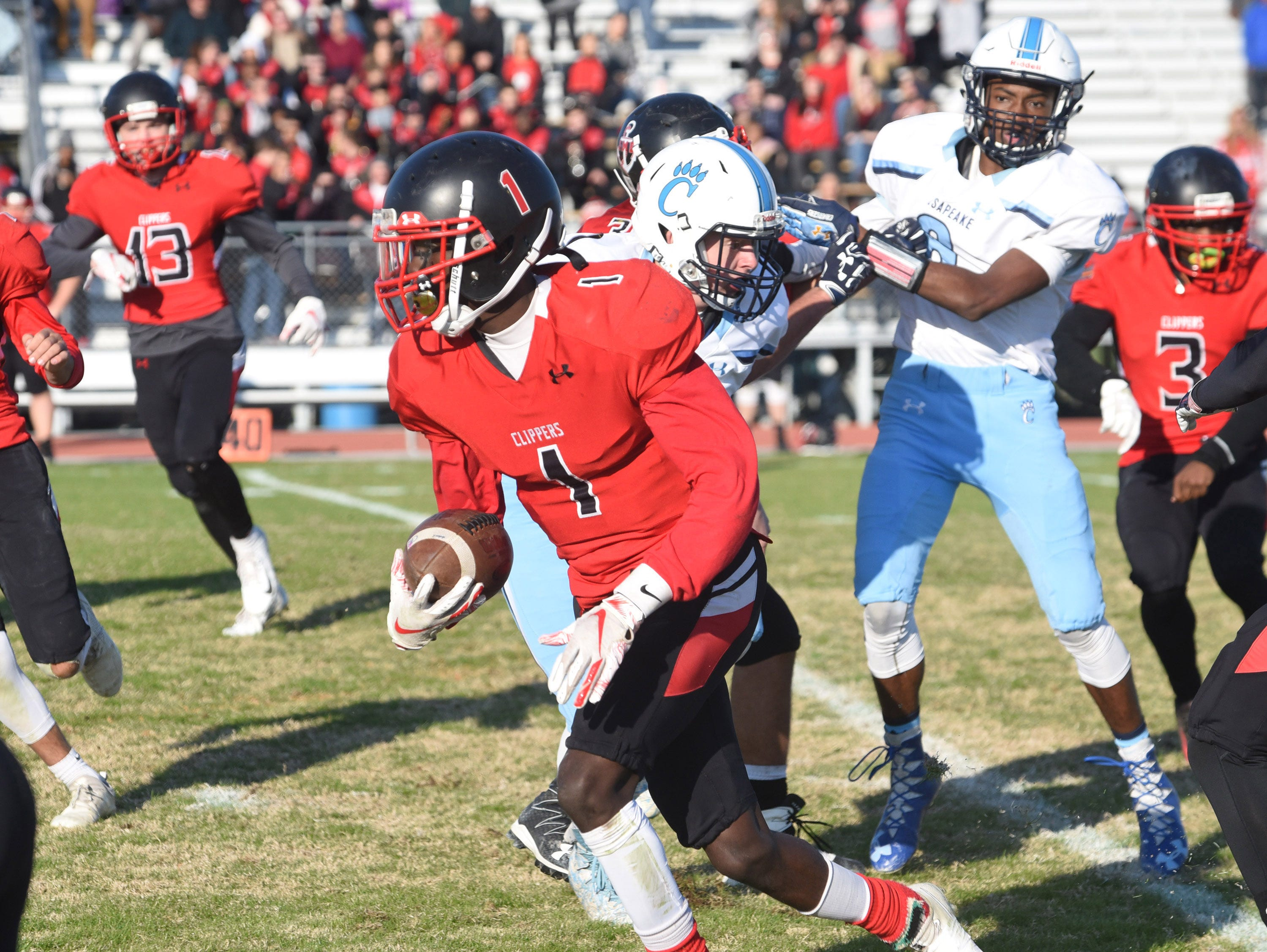 Bennett's Jahryn Long runs with the ball in the second half during James M. Bennett's playoff game vs. Chesapeake at County Stadium on Saturday.