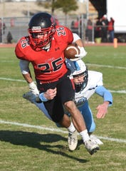 Bennett's Braden Glushakow runs with the ball in the second half during the squad's playoffs game vs. Chesapeake at County Stadium on Saturday.