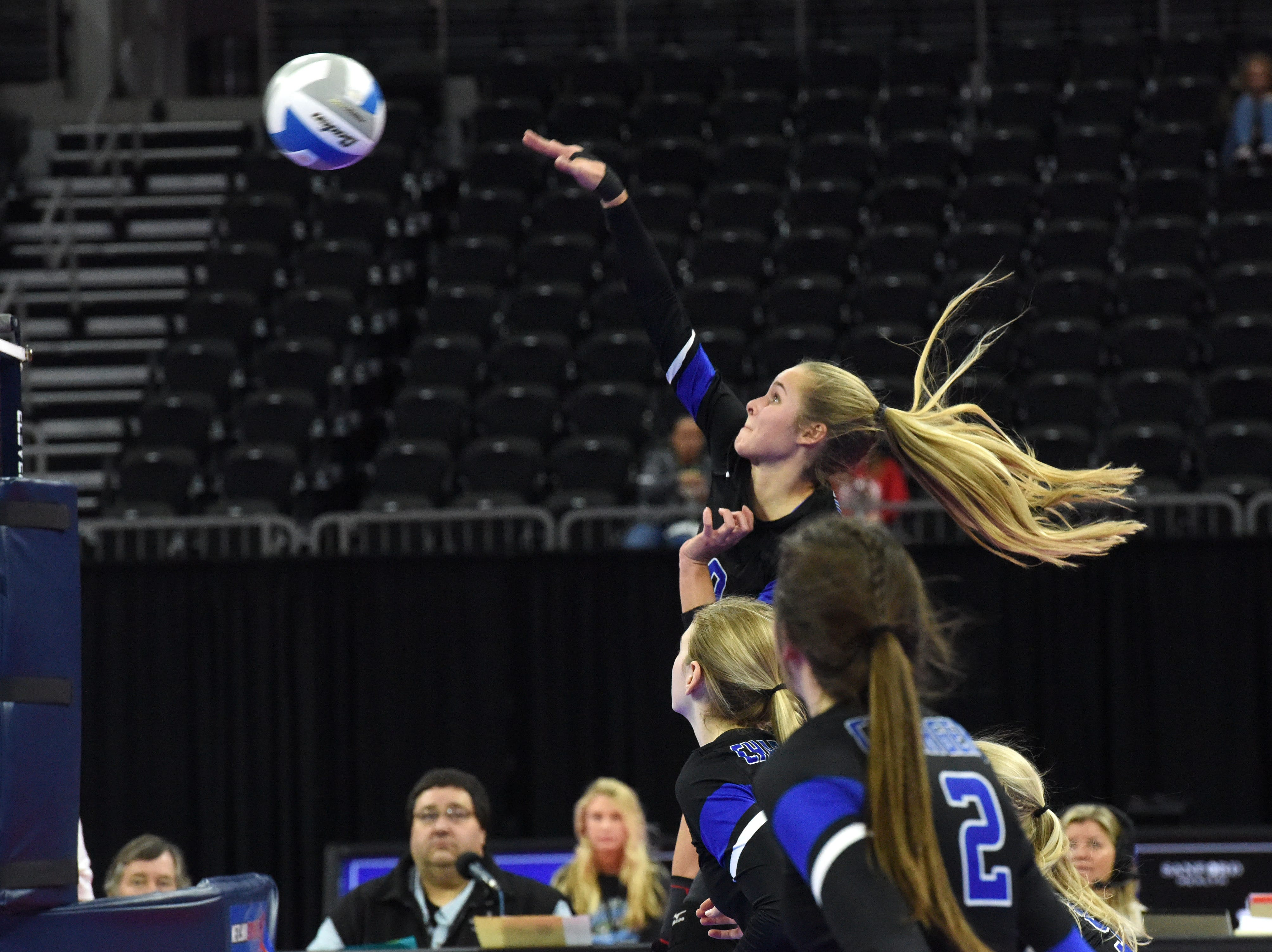 Sioux Falls Christian's Caitlyn Pruis (10) spikes the ball during a match against Miller, Saturday, Nov. 17, 2018, at the Denny Sanford Premier Center in Sioux Falls, S.D.