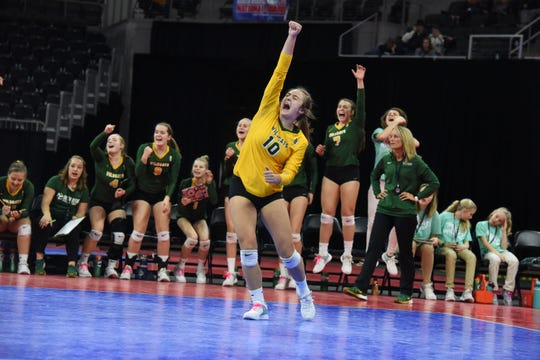 Northwestern's Tya Weideman (10) celebrates a point against Warner during last year's Class B championship match.