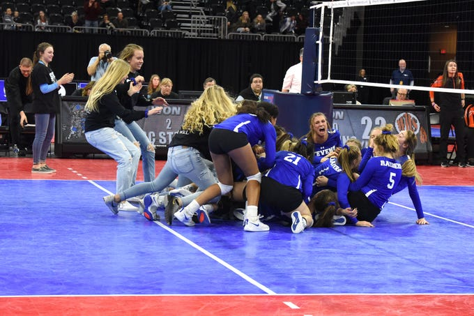 Rapid City team celebrates winning class AA state championship, Saturday, Nov. 17, 2018, at the Denny Sanford Premier Center in Sioux Falls, S.D.