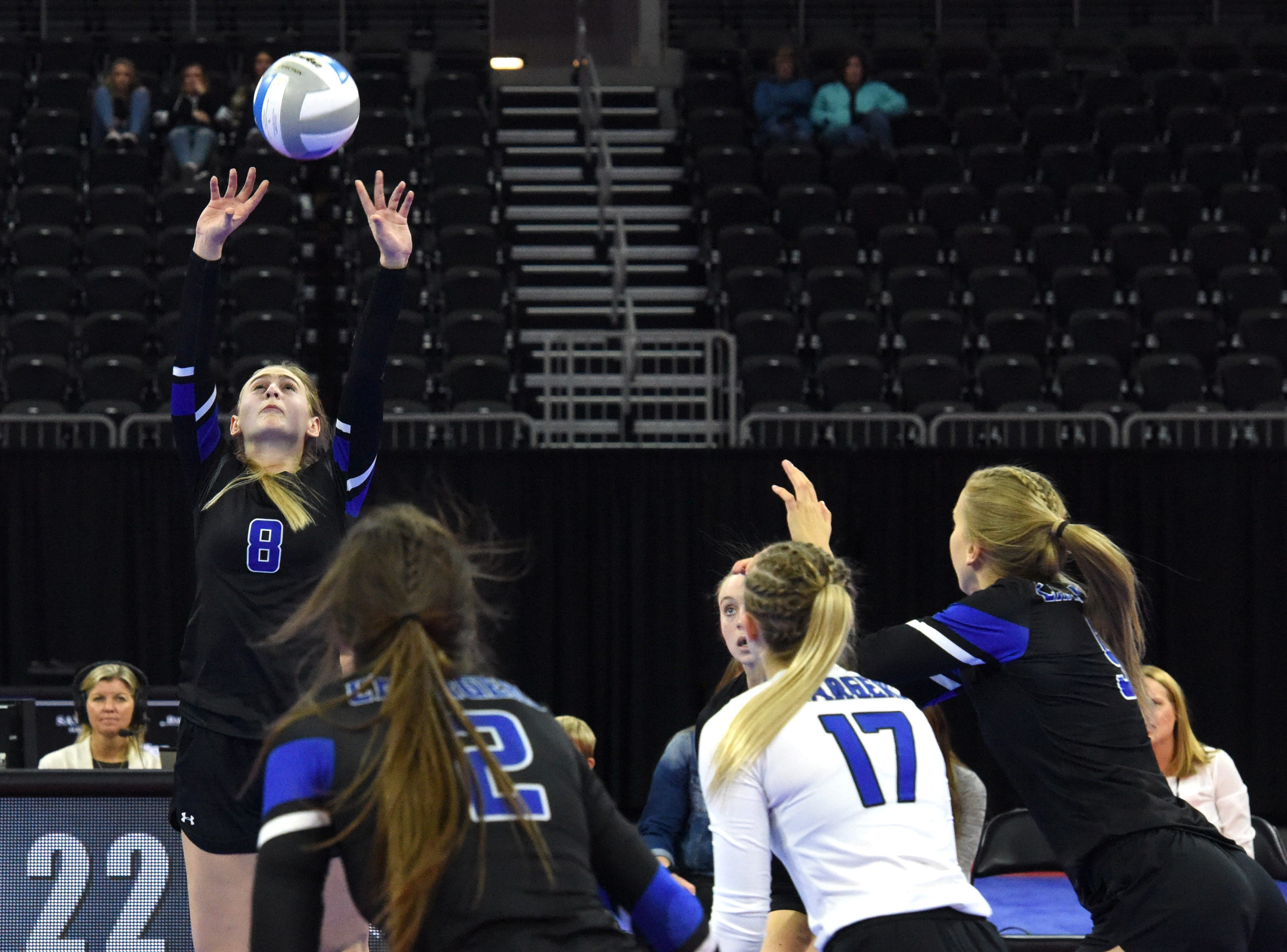 Sioux Falls Christian's Samantha Fykstra (8) sets the ball during a match against Miller, Saturday, Nov. 17, 2018, at the Denny Sanford Premier Center in Sioux Falls, S.D.